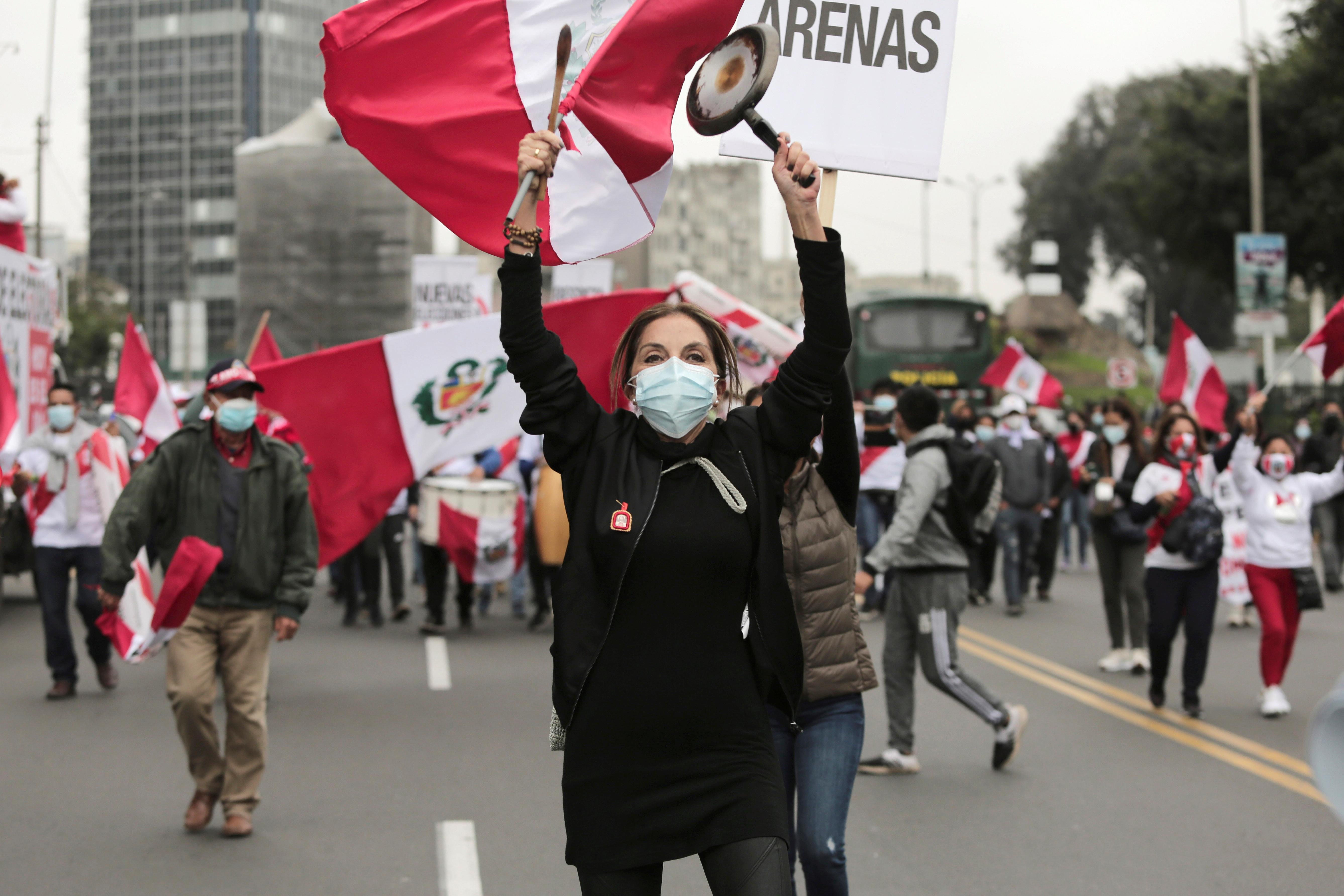 Supporters of Peru's presidential candidate Keiko Fujimori march in Lima, Peru June 19, 2021. REUTERS/Gerardo Marin