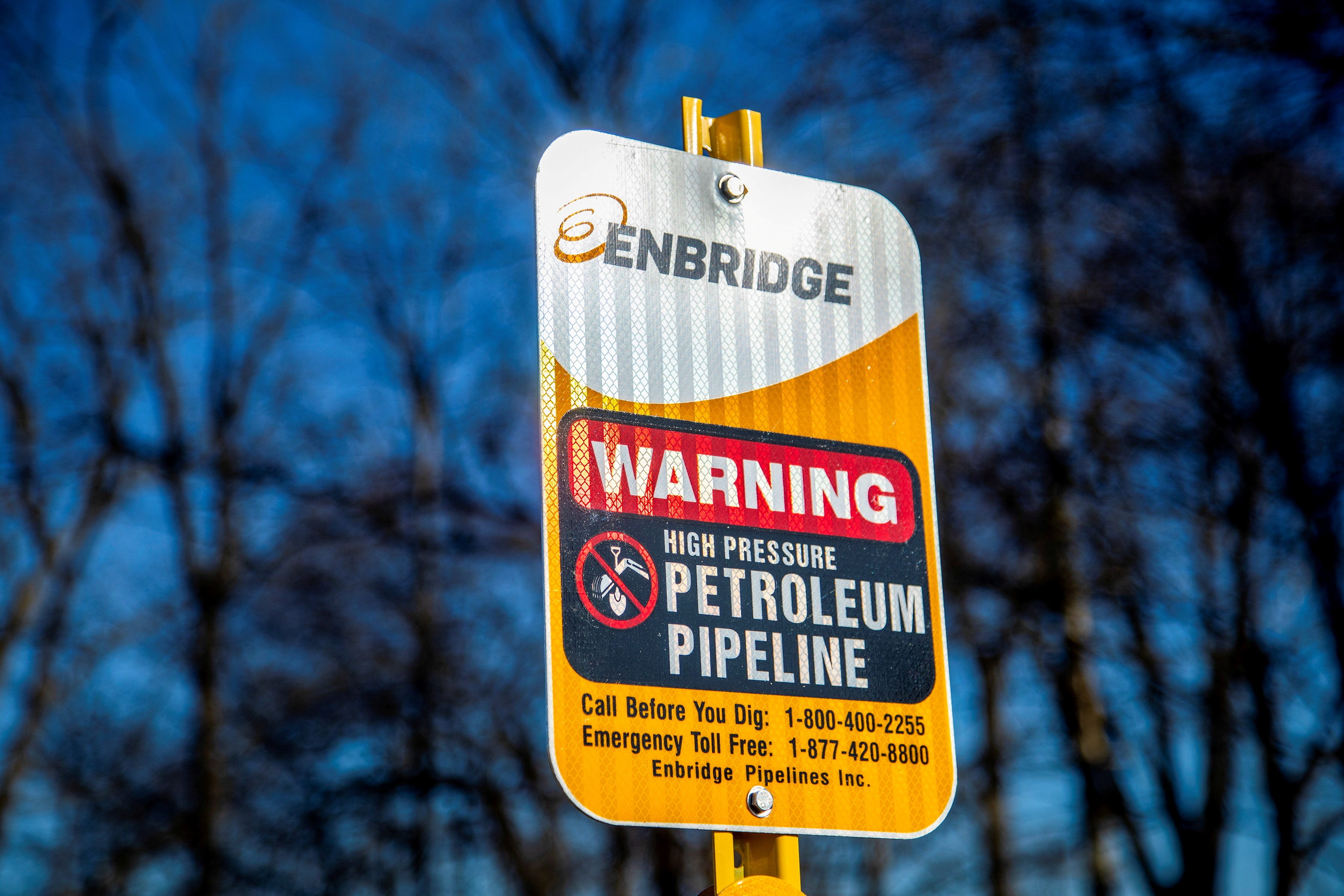 A signpost marks the presence of Enbridge's Line 5 pipeline, which Michigan Governor Gretchen Whitmer ordered shut down in May 2021, in Sarnia, Ontario, Canada March 20, 2021. Picture taken March 20, 2021. REUTERS/Carlos Osorio/File Photo