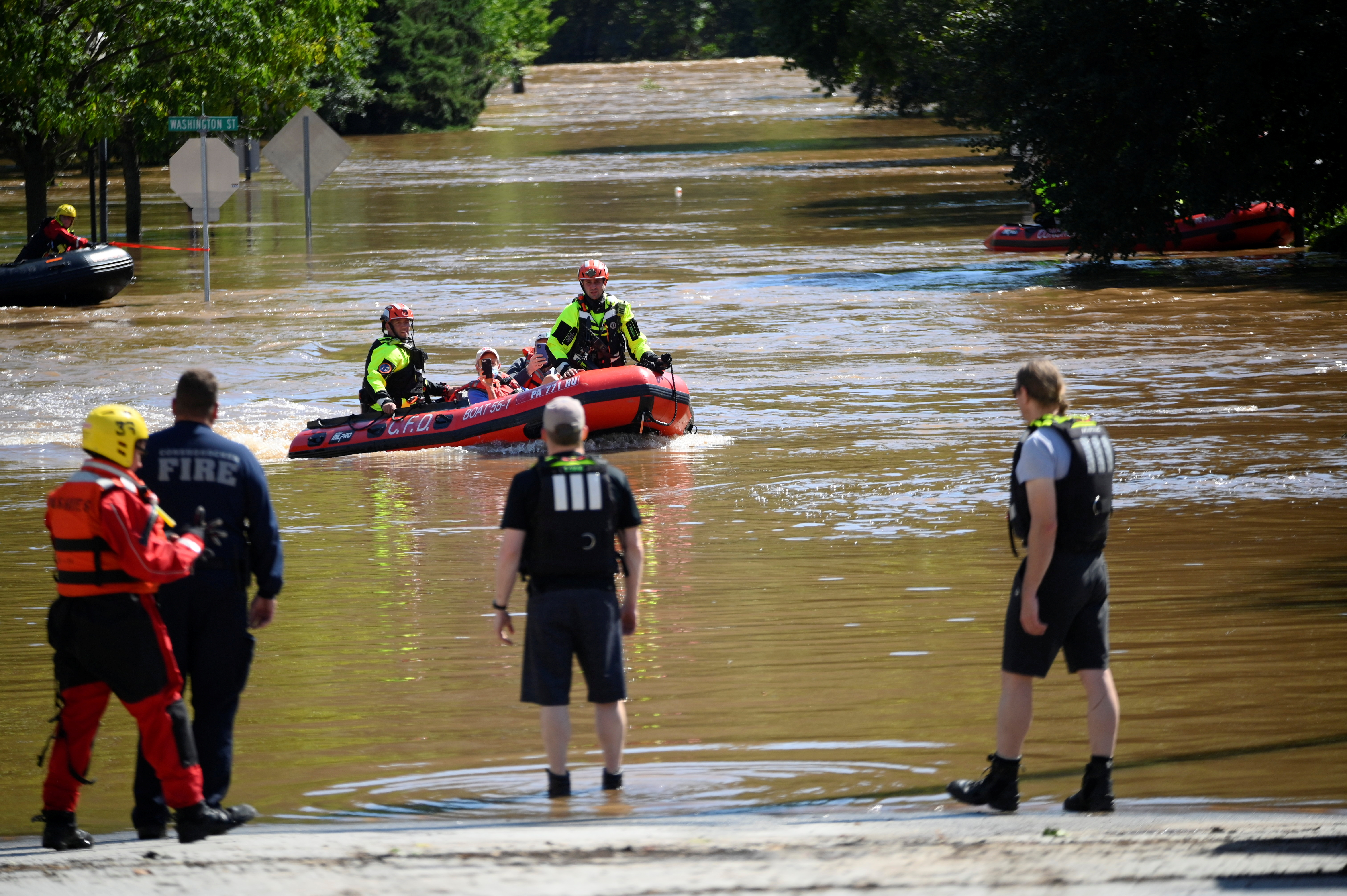 Emergency personnel conduct rescues for people trapped by floodwaters caused by the remnants of Tropical Storm Ida in Conshohocken, Pennsylvania, U.S., September 2, 2021. REUTERS/Bastiaan Slabbers