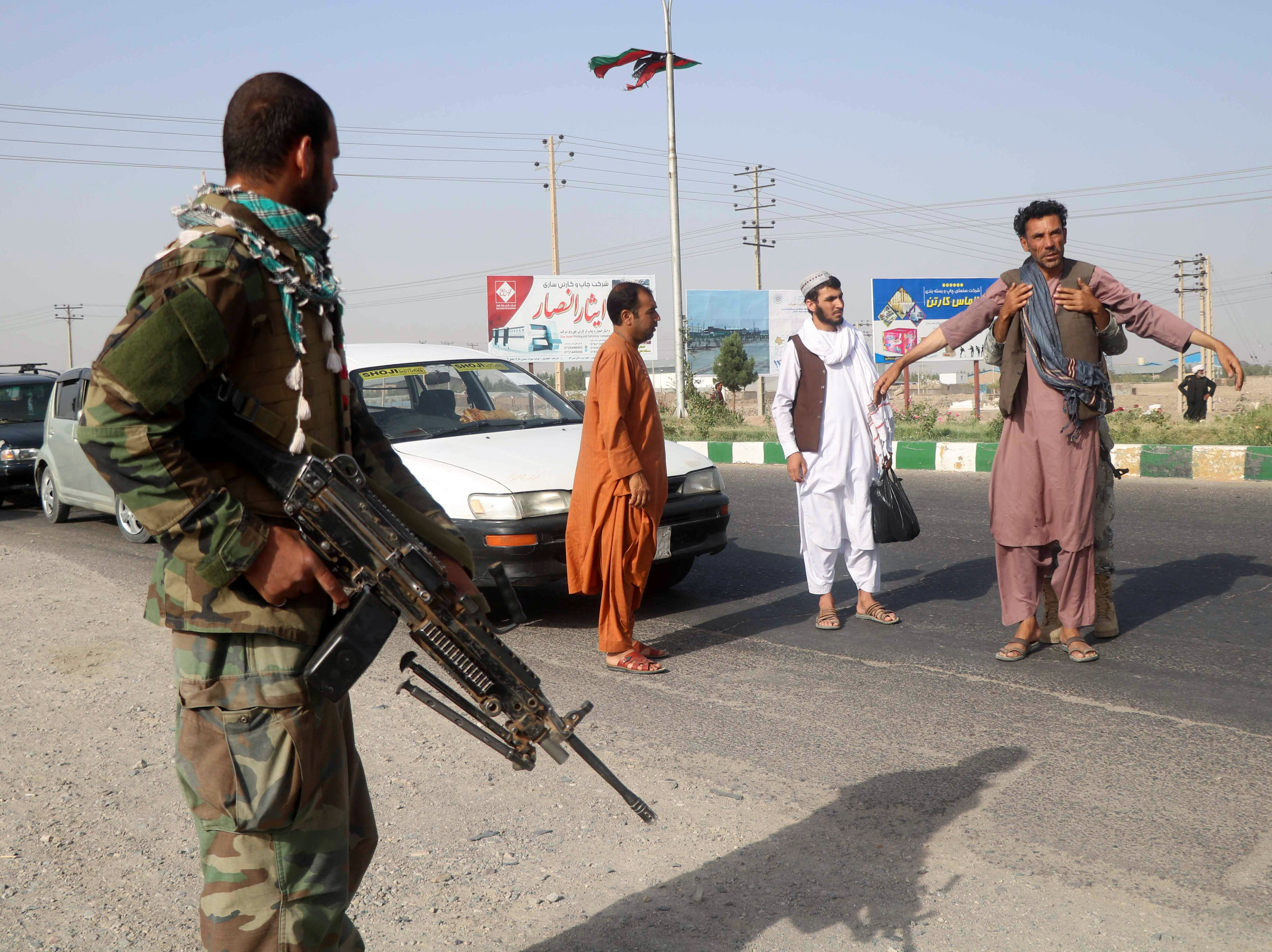 An Afghan National Army (ANA) soldier searches a man at a checkpoint in the Guzara district of Herat province, Afghanistan July 9, 2021. REUTERS/Jalil Ahmad