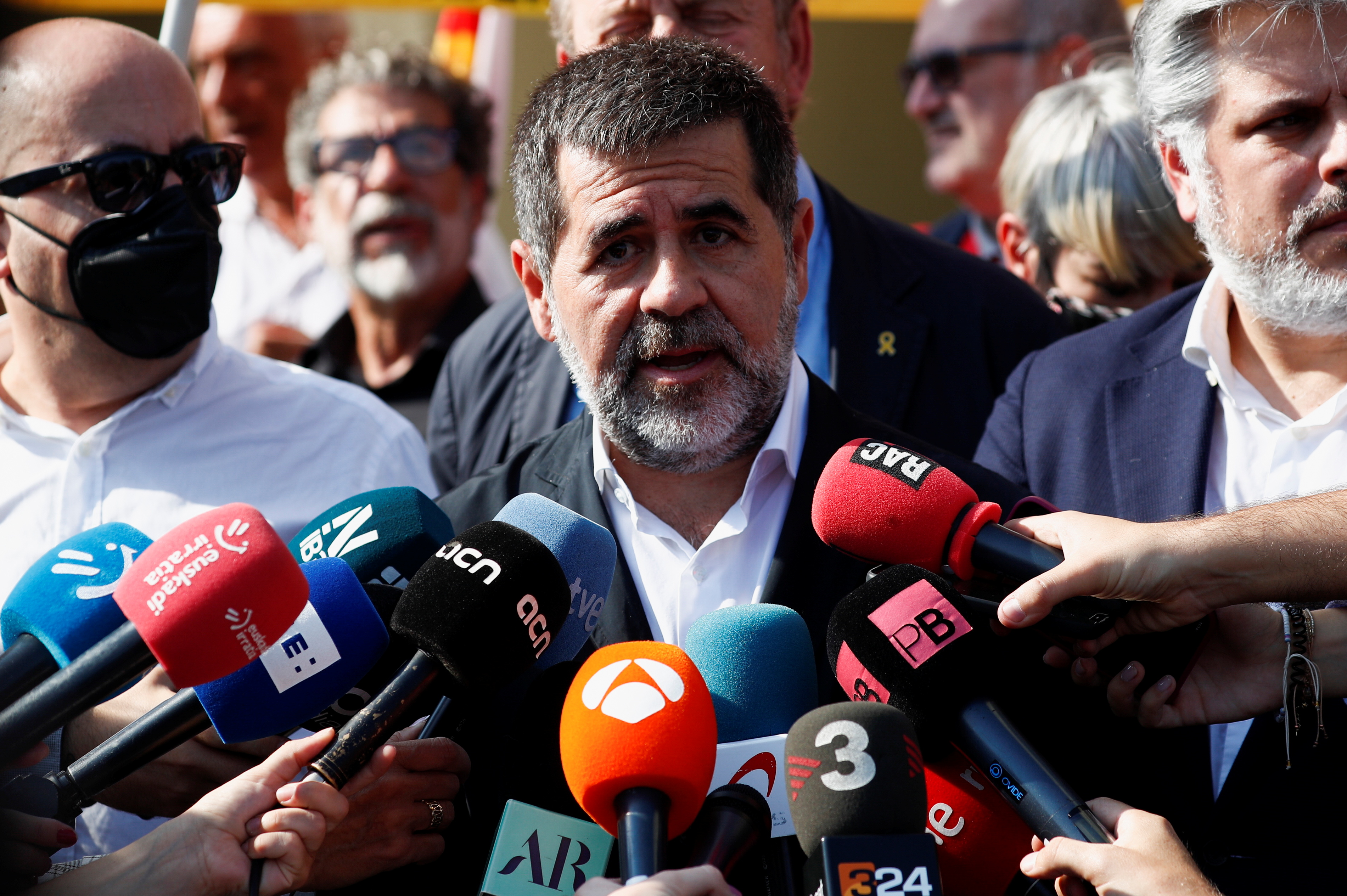 Jordi Sanchez speaks to the media, as Catalan separatist leader Carles Puigdemont (not pictured) arrives at a courthouse in Sardinia at the first hearing on his European arrest warrant, in Sassari, Italy, October 4, 2021. REUTERS/Guglielmo Mangiapane