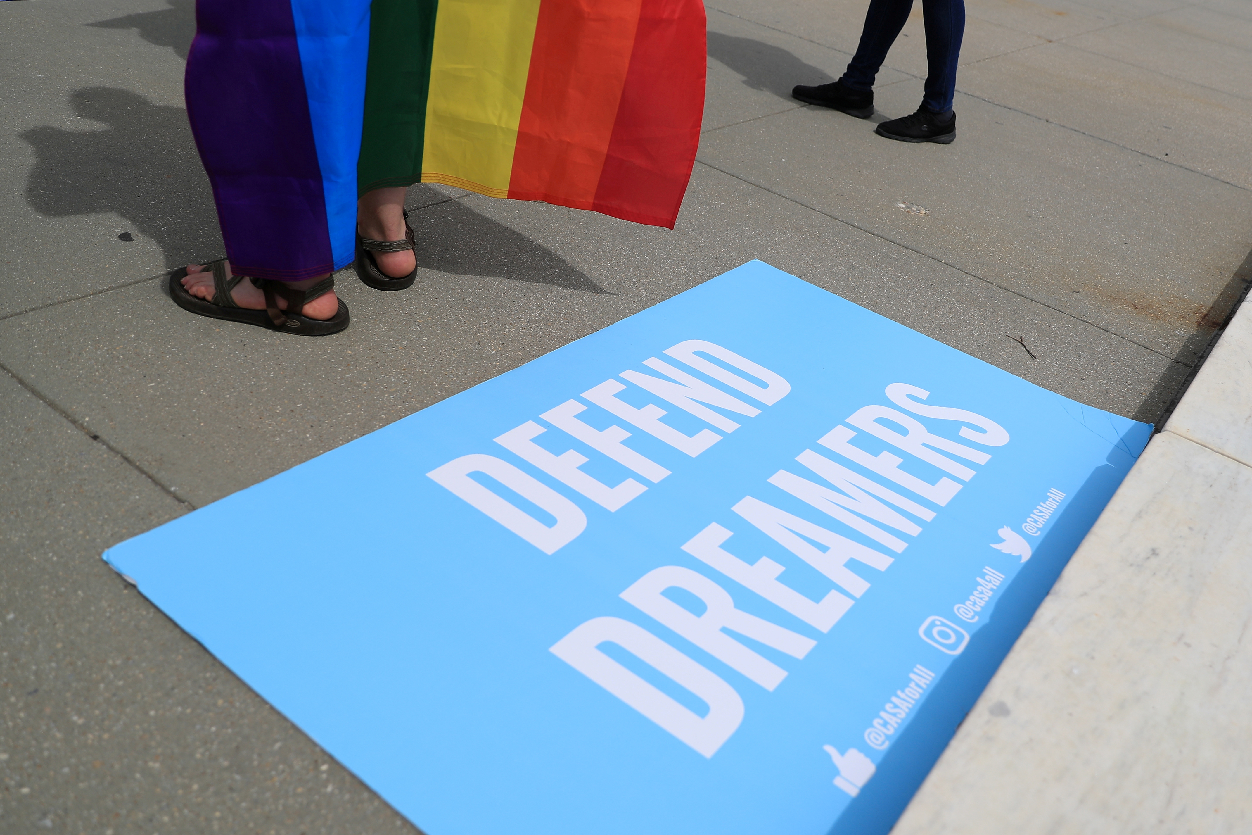 A sign in support of DACA Dreamers lies at the steps of the U.S. Supreme Court after the court declined to hear a Trump administration challenge to California's sanctuary laws, in Washington, D.C. June 15, 2020. REUTERS/Tom Brenner