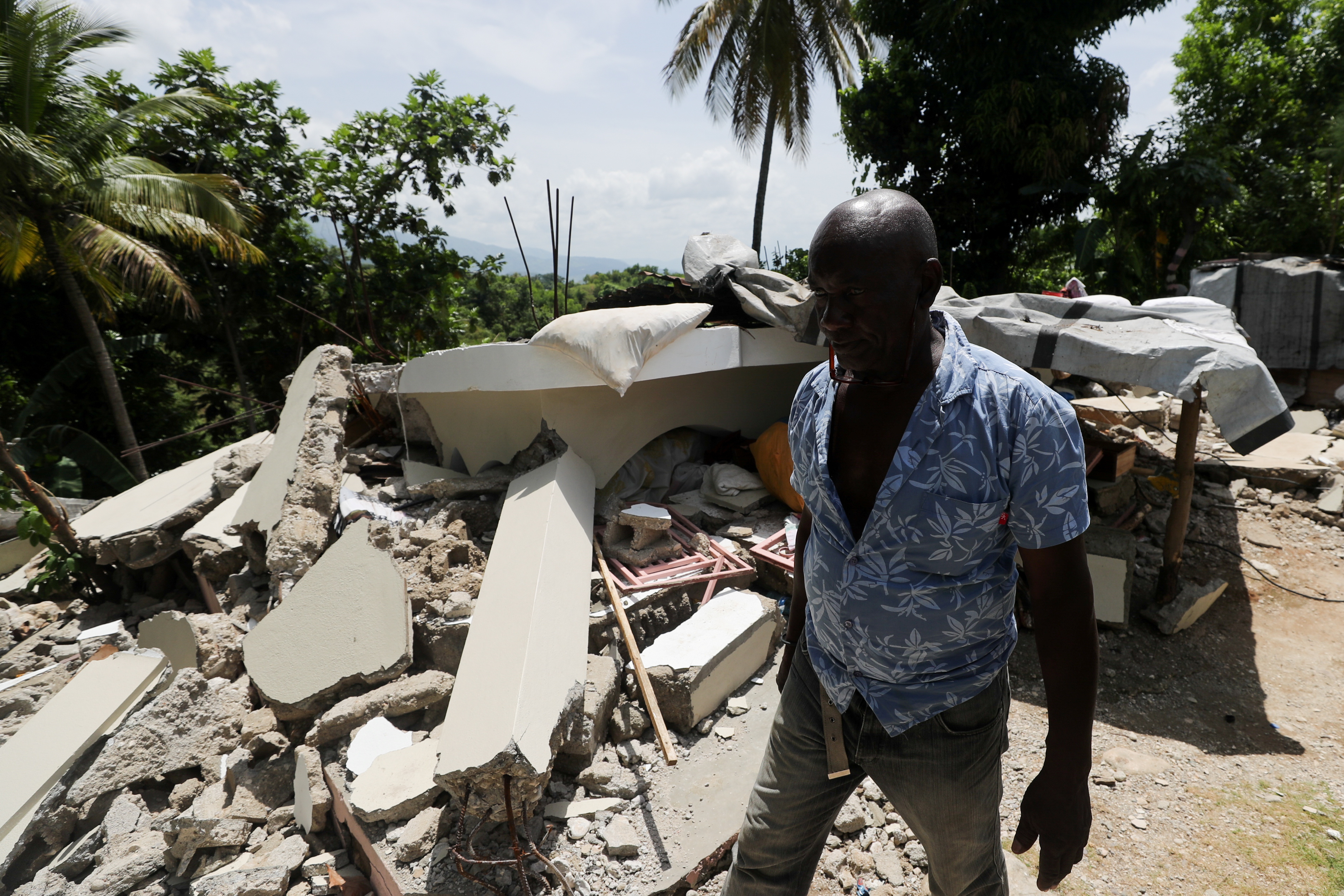 A resident walks among destroyed houses, after the earthquake that took place on August 14th, in Marceline, near Les Cayes, Haiti August 20, 2021. REUTERS/Henry Romero
