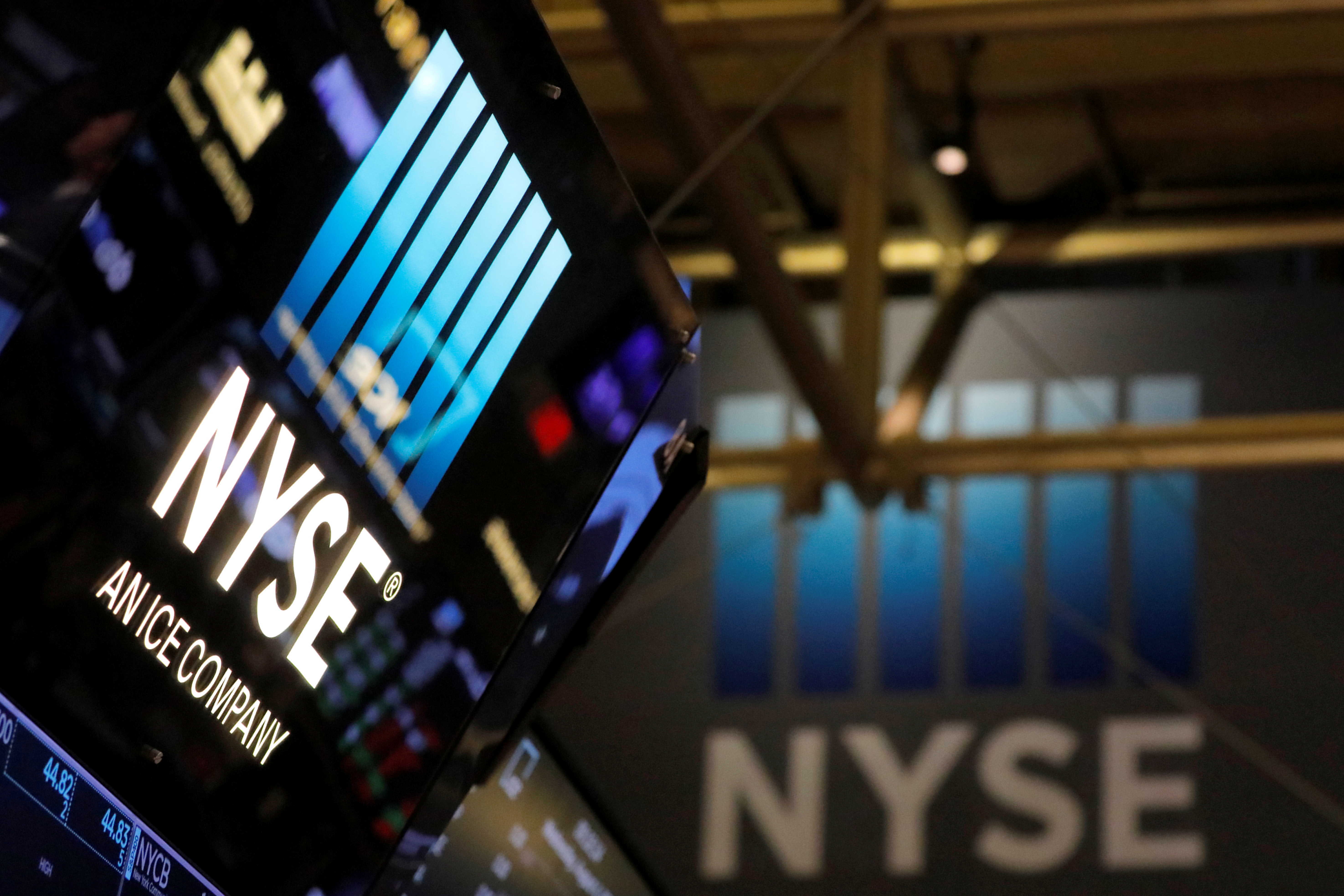 Signage is seen on the trading floor at the New York Stock Exchange (NYSE) in Manhattan, New York City, U.S., August 4, 2021. REUTERS/Andrew Kelly