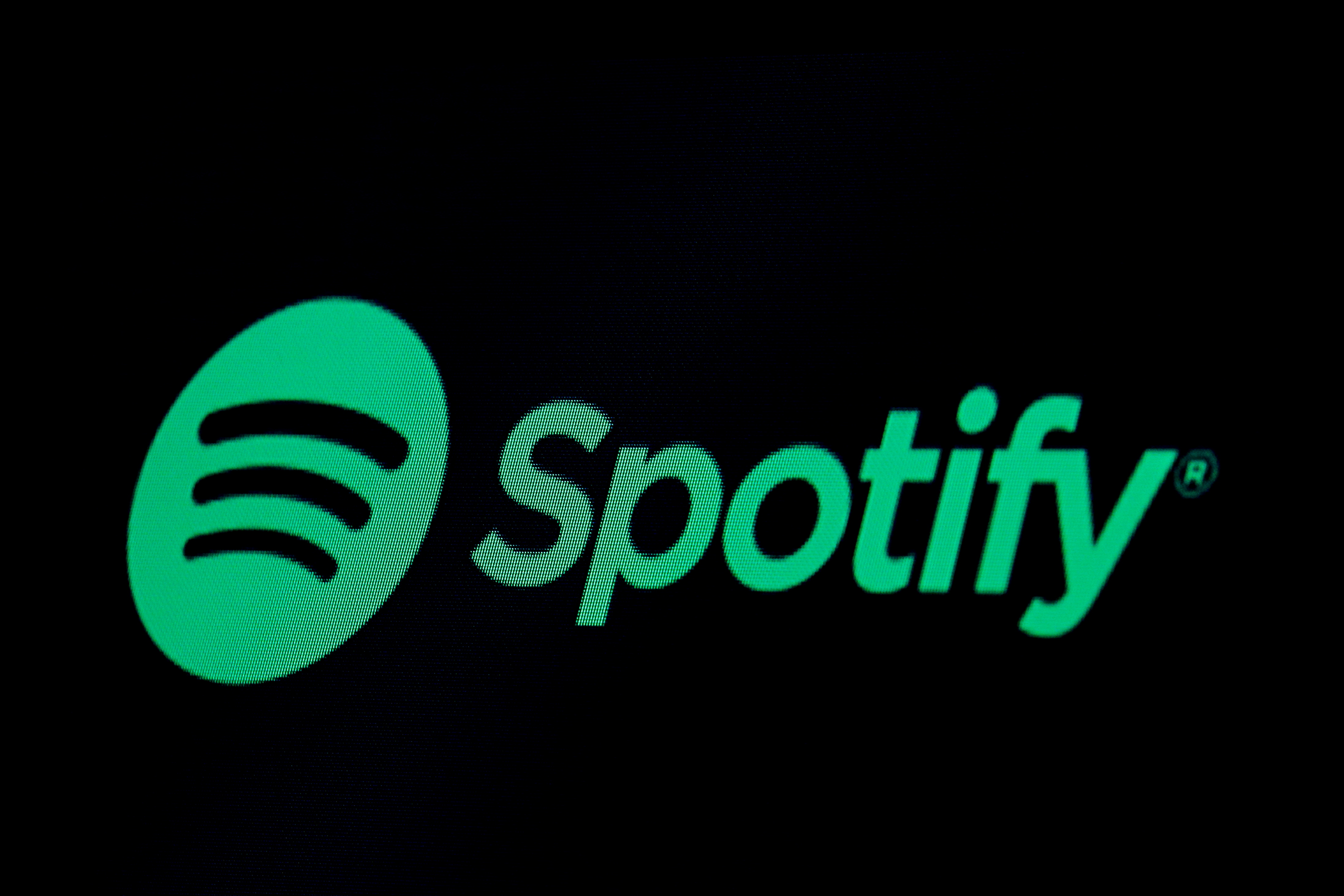 The Spotify logo is displayed on a screen on the floor of the New York Stock Exchange (NYSE) in New York, U.S., May 3, 2018. REUTERS/Brendan McDermid/File Photo