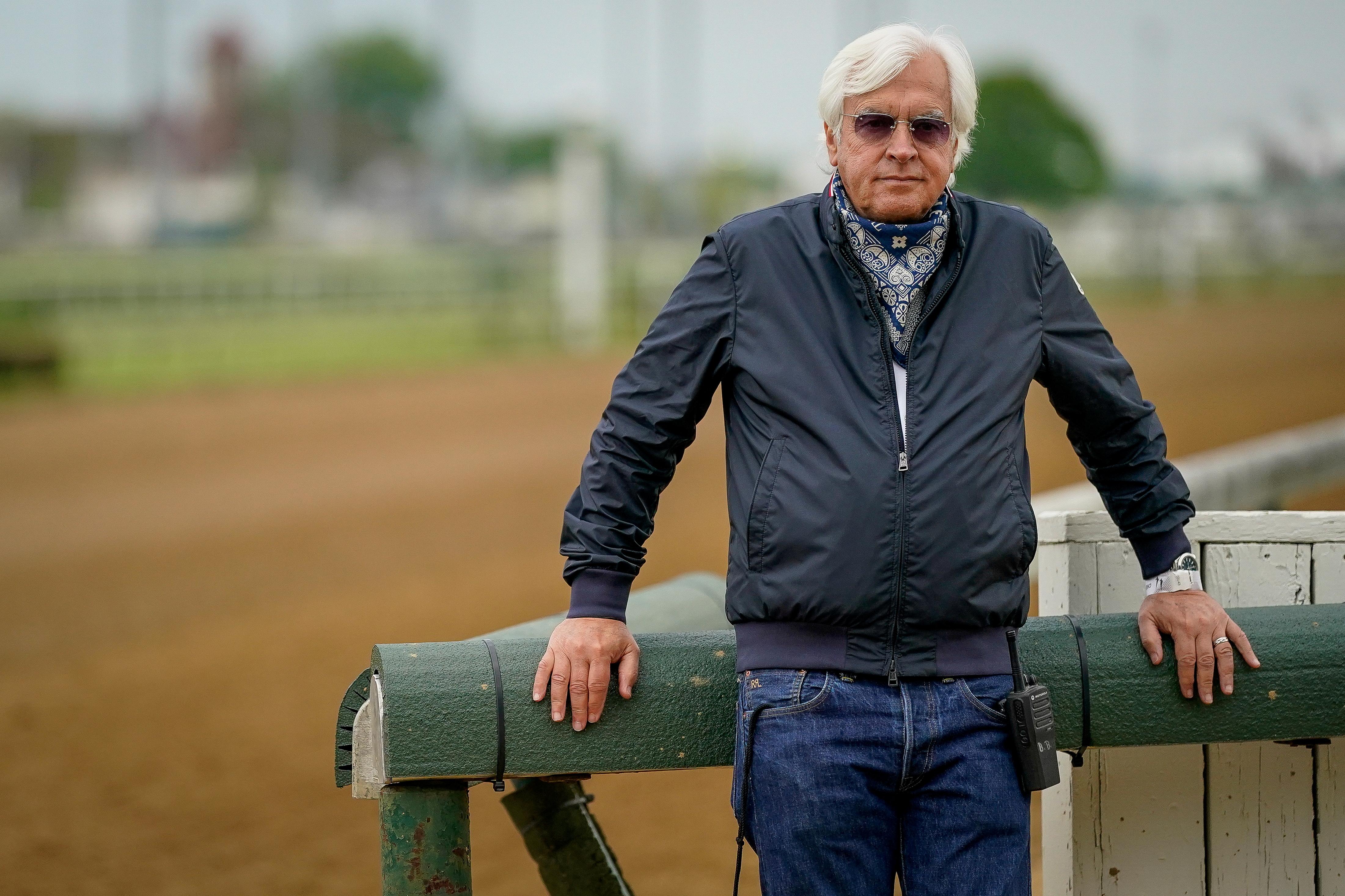 Bob Baffert, trainer of Kentucky Derby winner Medina Spirit, stands near the track at Churchill Downs in Louisville, Kentucky, U.S. April 28, 2021. REUTERS/Bryan Woolston/File Photo