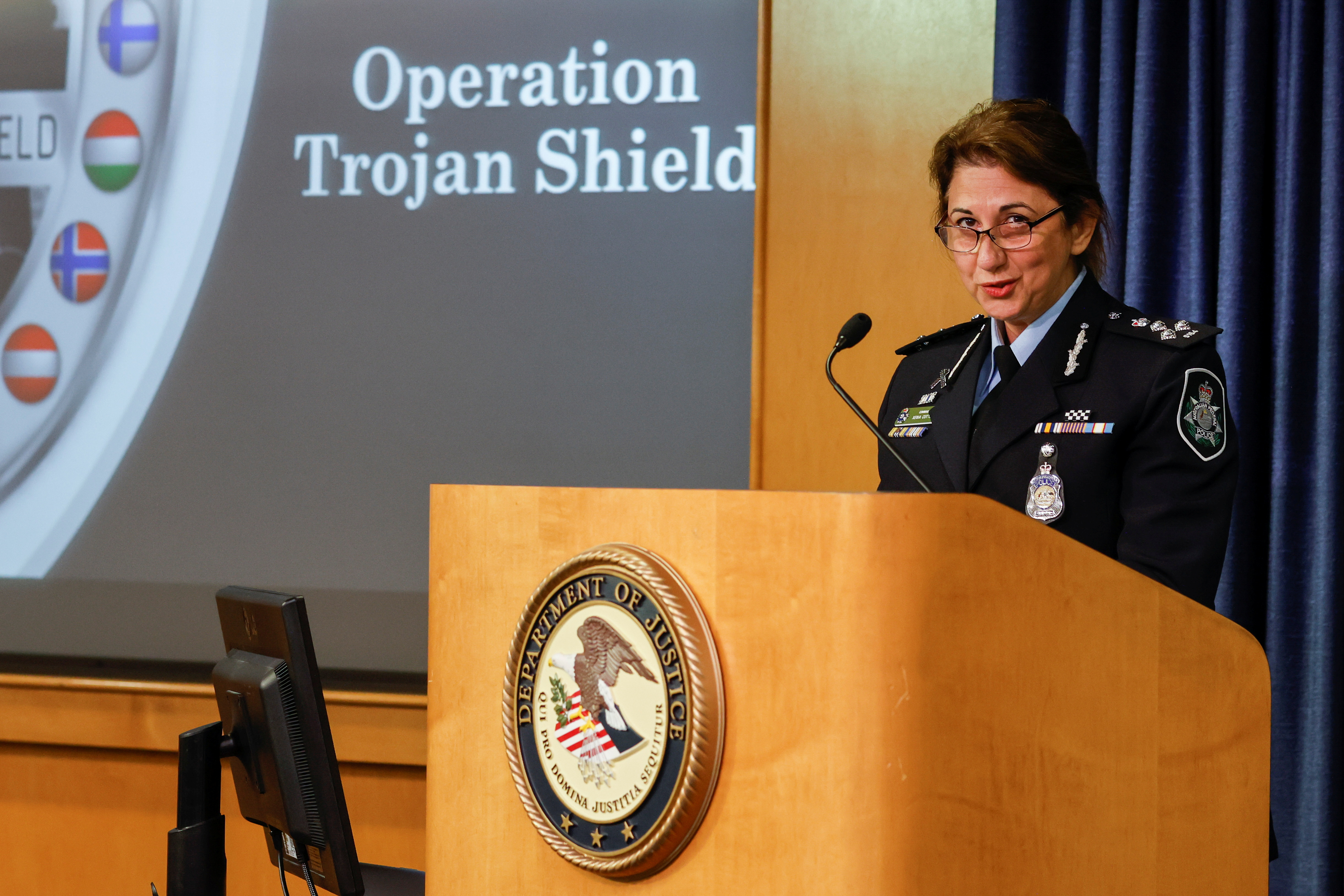 Commander Xenia Cotter from the Australian Federal Police speaks during a news conference to announce a massive worldwide takedown based on the FBI's investigation involving the interception of encrypted communications in San Diego, California, U.S. June 8, 2021.REUTERS/Mike Blake
