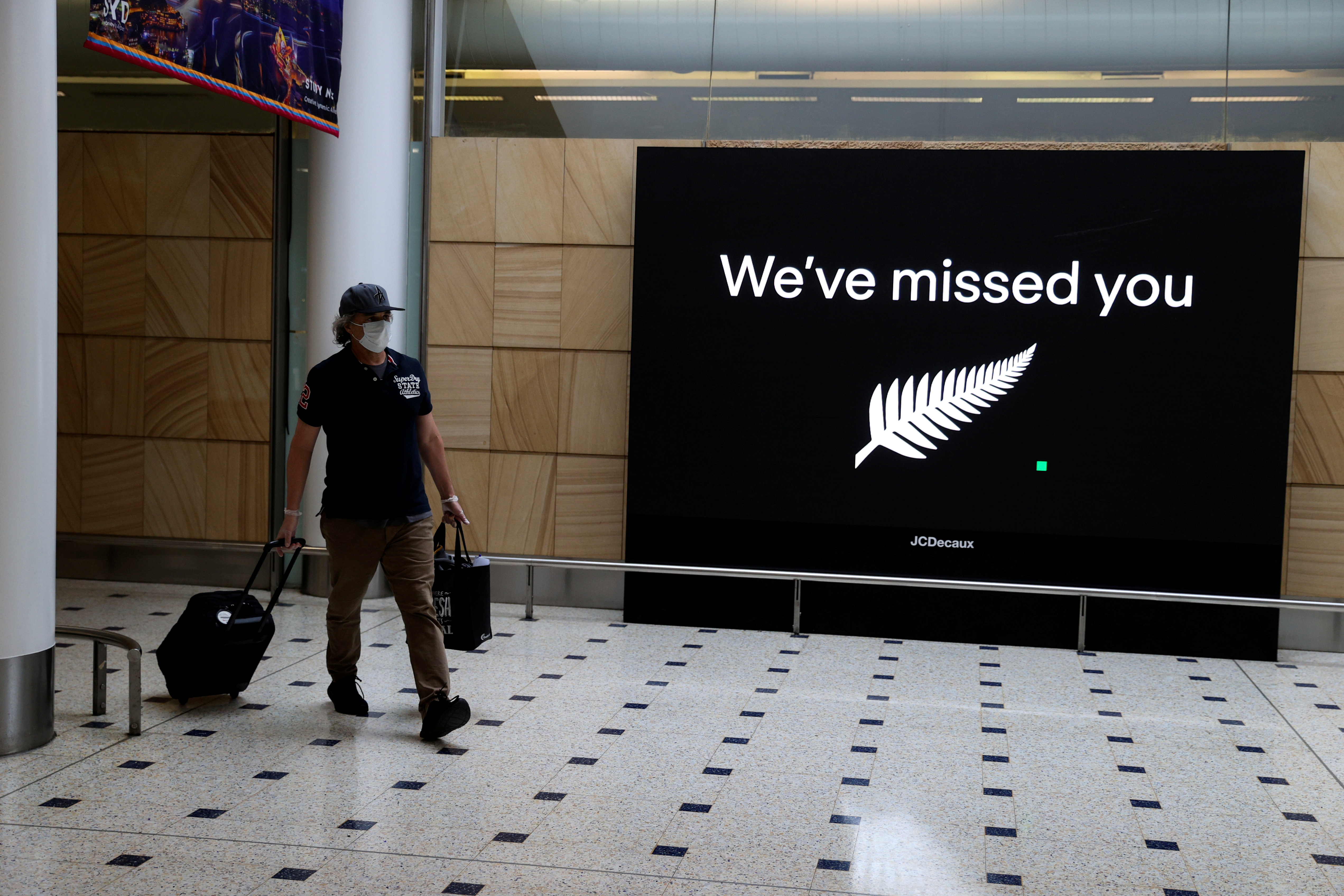 A passenger arrives from New Zealand after the Trans-Tasman travel bubble opened overnight, following an extended border closure due to the coronavirus disease (COVID-19) outbreak, at Sydney Airport in Sydney, Australia, October 16, 2020. REUTERS/Loren Elliott/File Photo