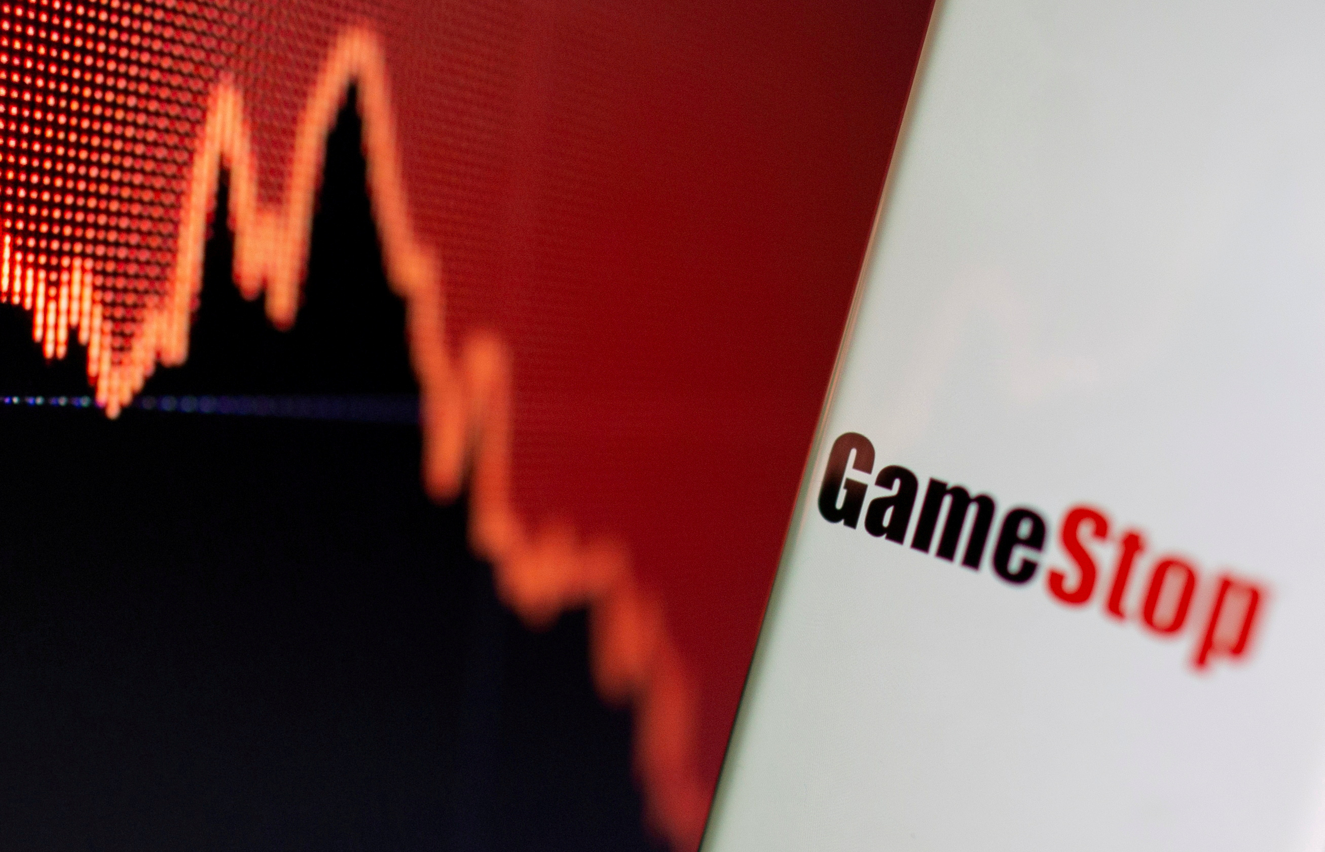 GameStop logo is seen near displayed stock graph in this illustration taken February 2, 2021. REUTERS/Dado Ruvic/Illustration