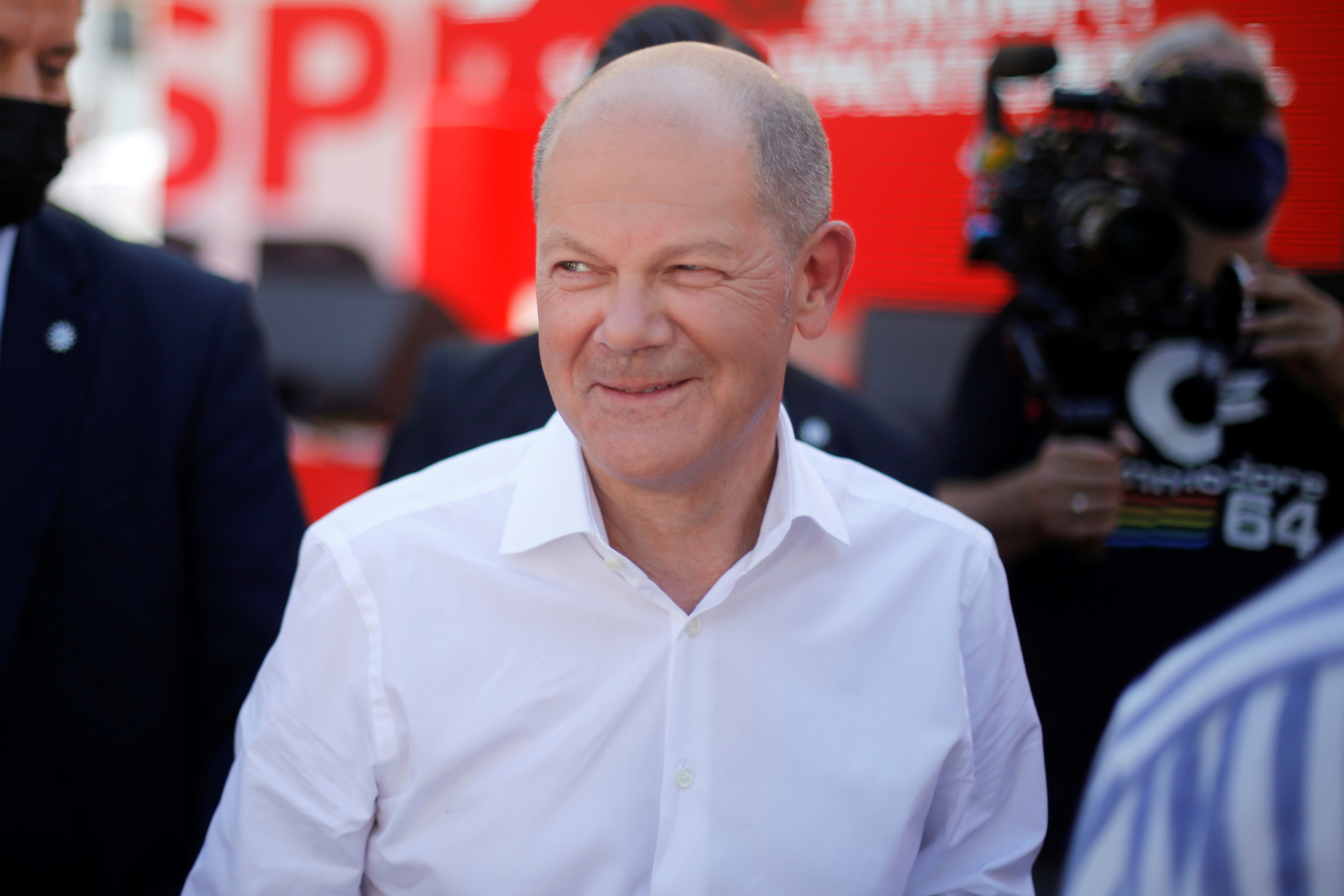 SPD Chancellor candidate Olaf Scholz looks on after an event to kick off his campaign, in Bochum, Germany, August 14, 2021. REUTERS/Leon Kuegeler/Pool