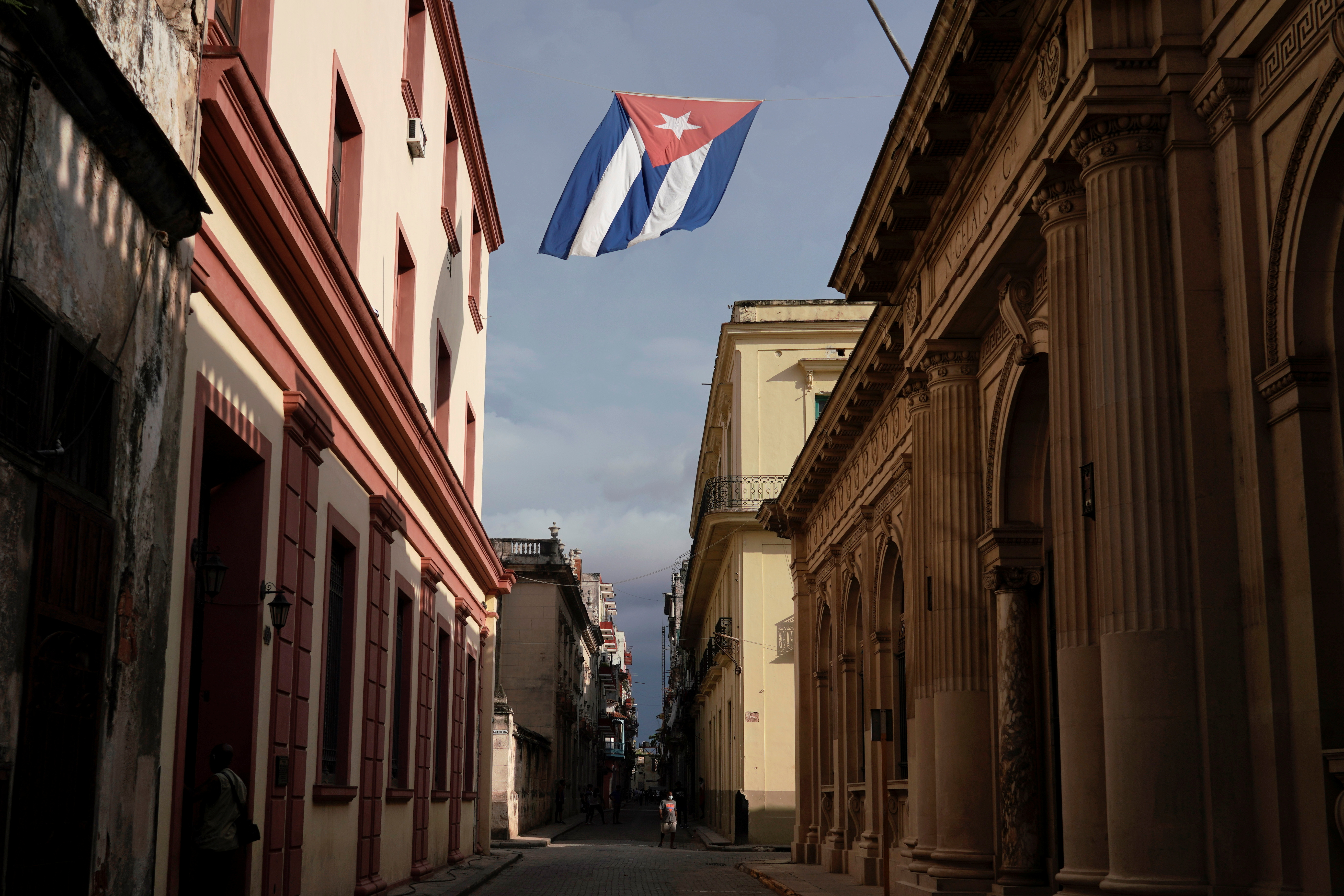 A Cuban flag flies over a street amid concerns about the spread of the coronavirus disease (COVID-19) in downtown Havana, Cuba, July 18, 2021. Picture taken July 18, 2021. REUTERS/Alexandre Meneghini