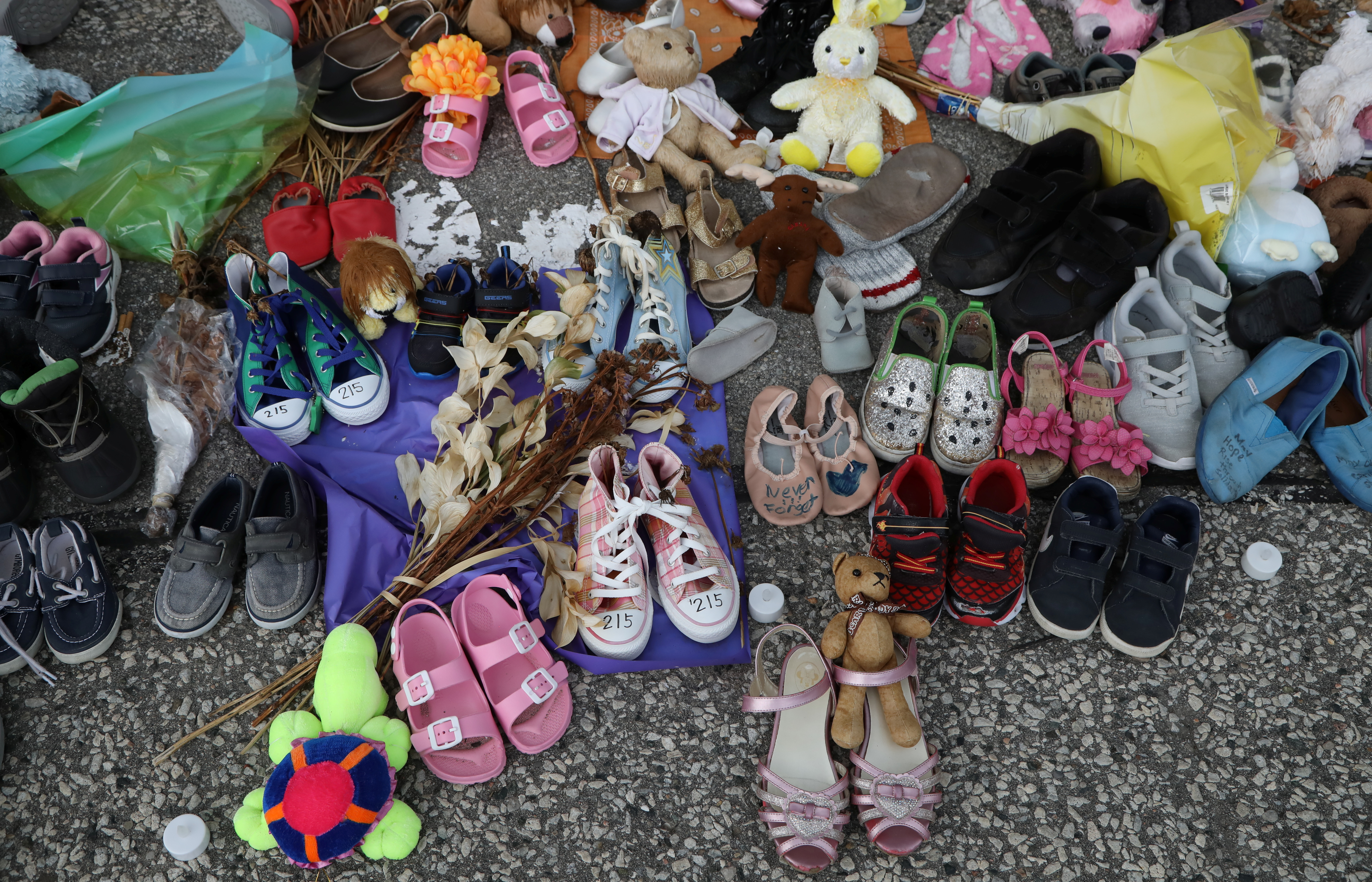 Baby shoes are placed at the Queens Park provincial legislature, after the discovery of hundreds of remains of children at former indigenous residential schools, on Canada Day in Toronto, Ontario, Canada July 1, 2021. REUTERS/Carlos Osorio