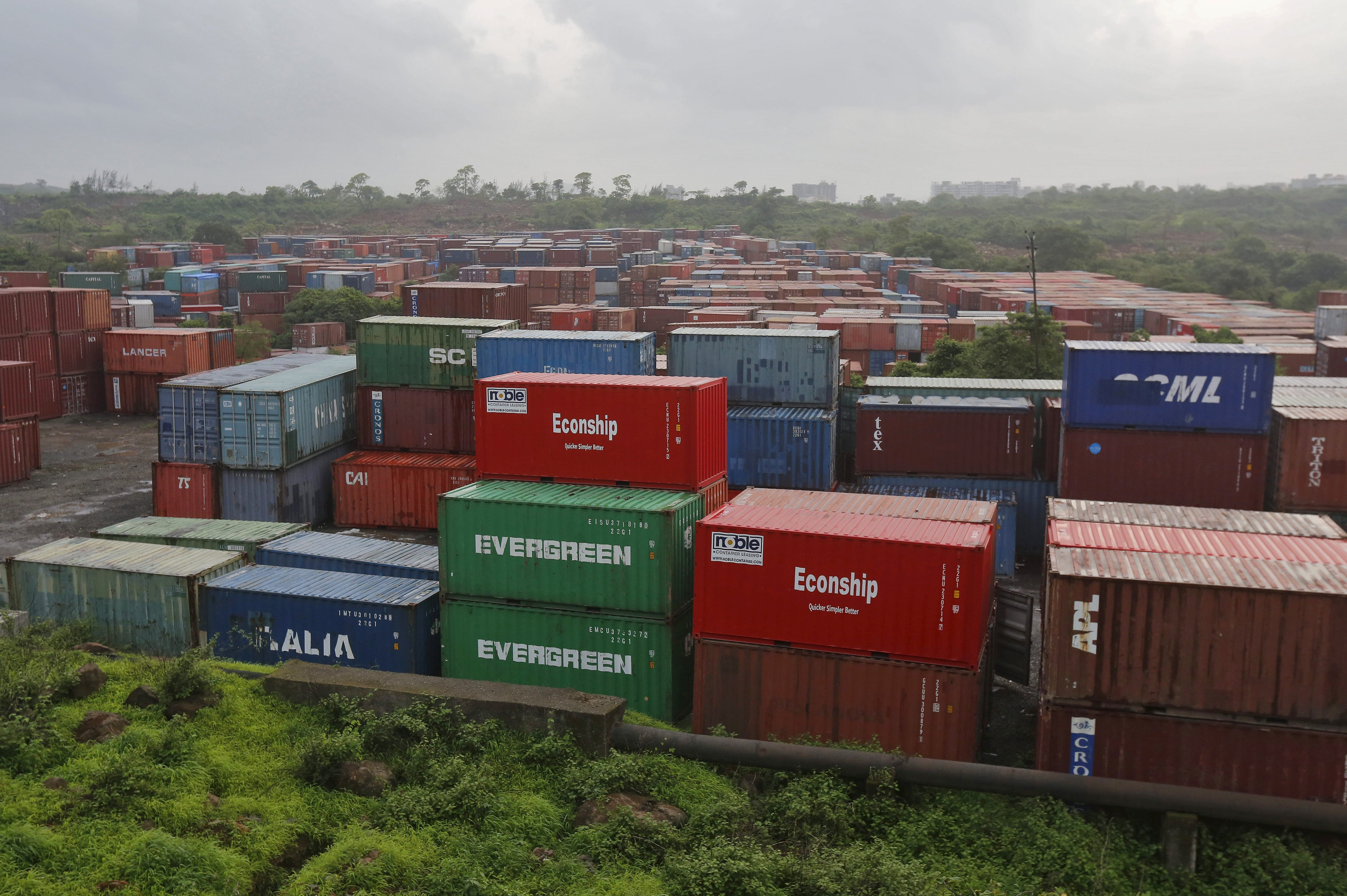 Cargo containers are seen stacked outside the container terminal of Jawaharlal Nehru Port Trust (JNPT) in Mumbai, India, July 15, 2015.  REUTERS/Shailesh Andrade/File Photo