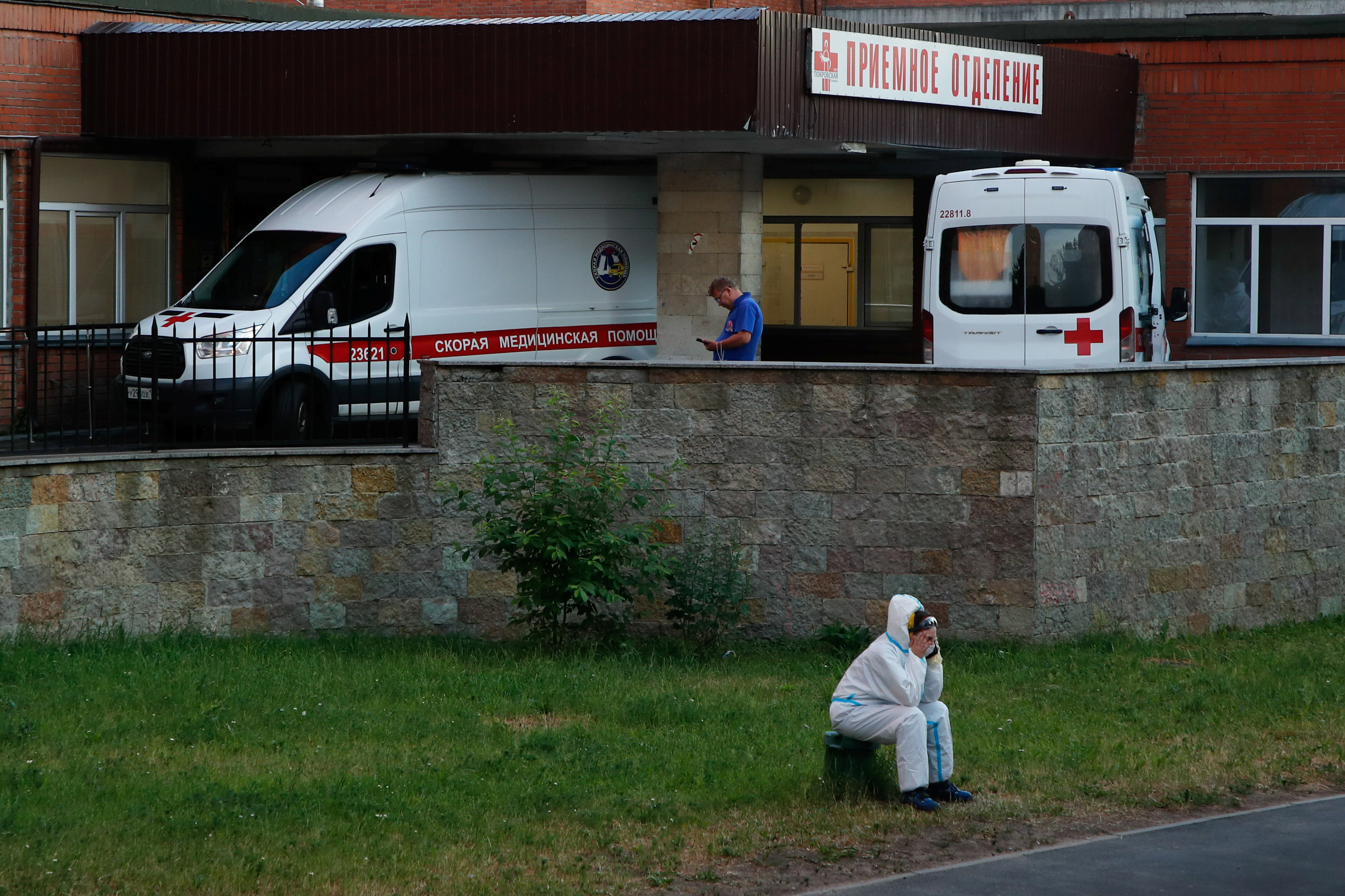 A medical specialist wearing protective gear sits near ambulances parked at the Pokrovskaya hospital amid the outbreak of the coronavirus disease (COVID-19) in Saint Petersburg, Russia June 24, 2021.  REUTERS/Anton Vaganov