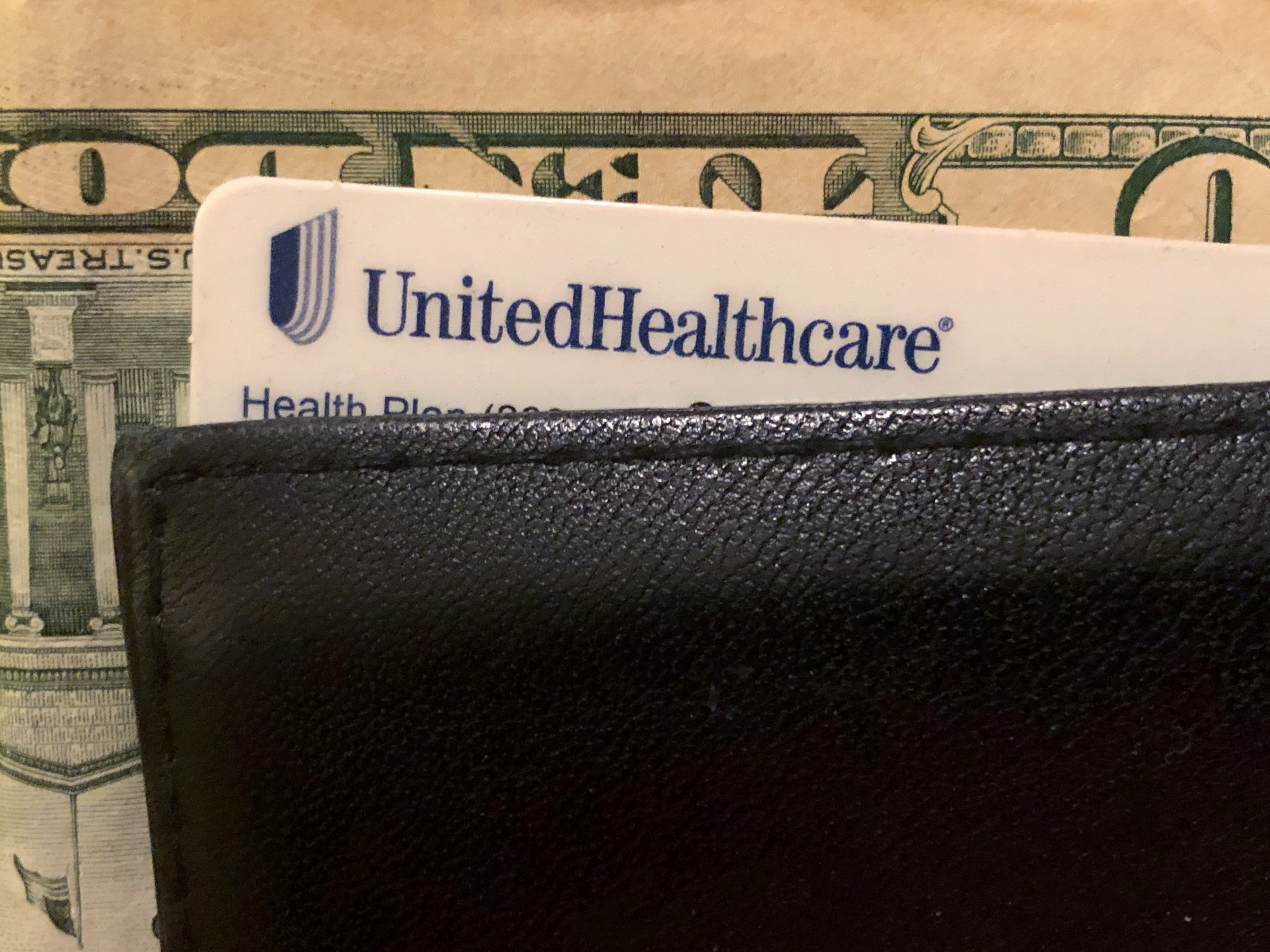 A UnitedHealth Group health insurance card is seen in a wallet in this picture illustration October 14, 2019. REUTERS/Lucy Nicholson/Illustration/File Photo