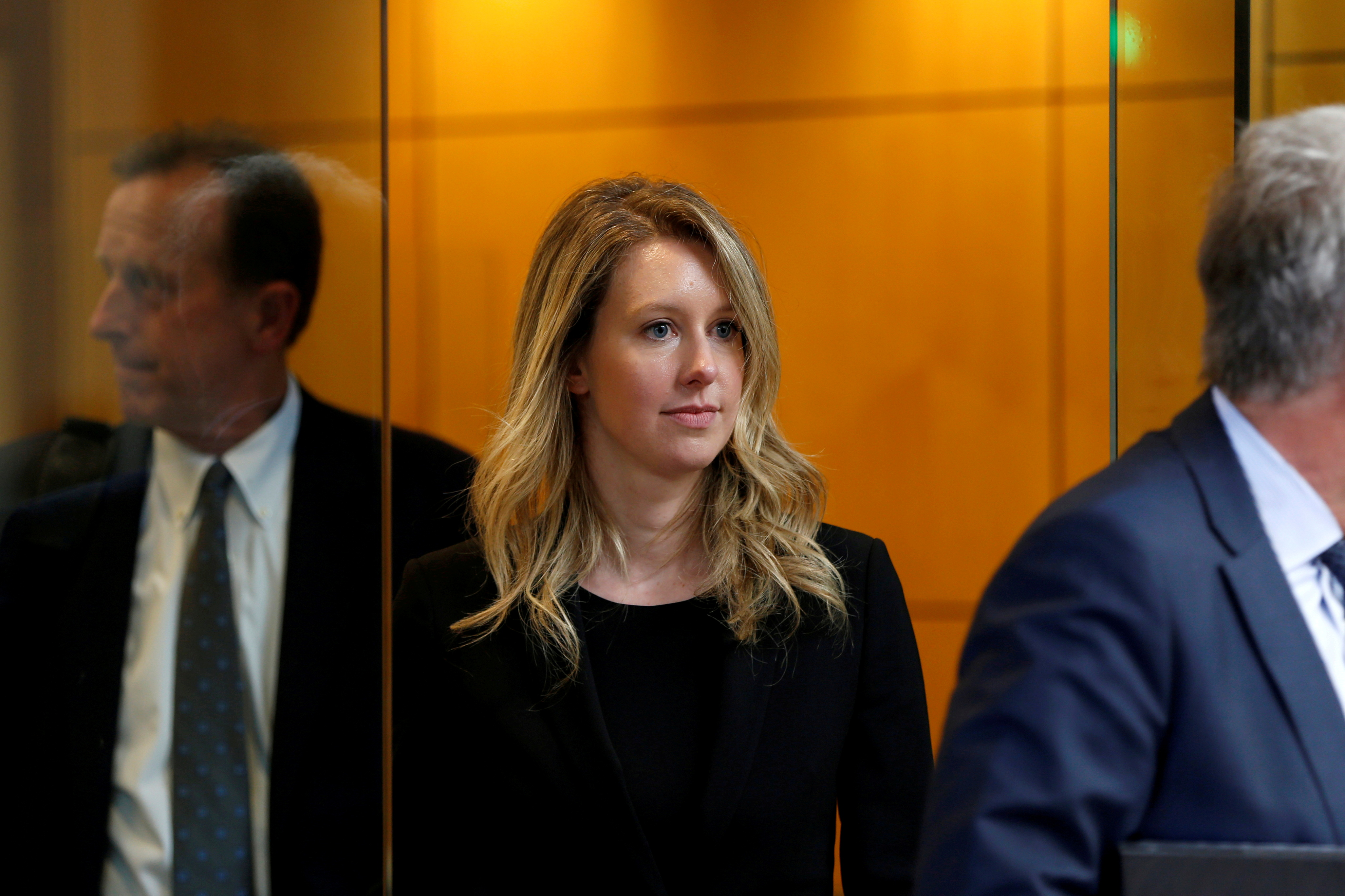 Former Theranos CEO Elizabeth Holmes leaves after a hearing at a federal court in San Jose, California, July 17, U.S., 2019.  REUTERS/Stephen Lam/File Photo