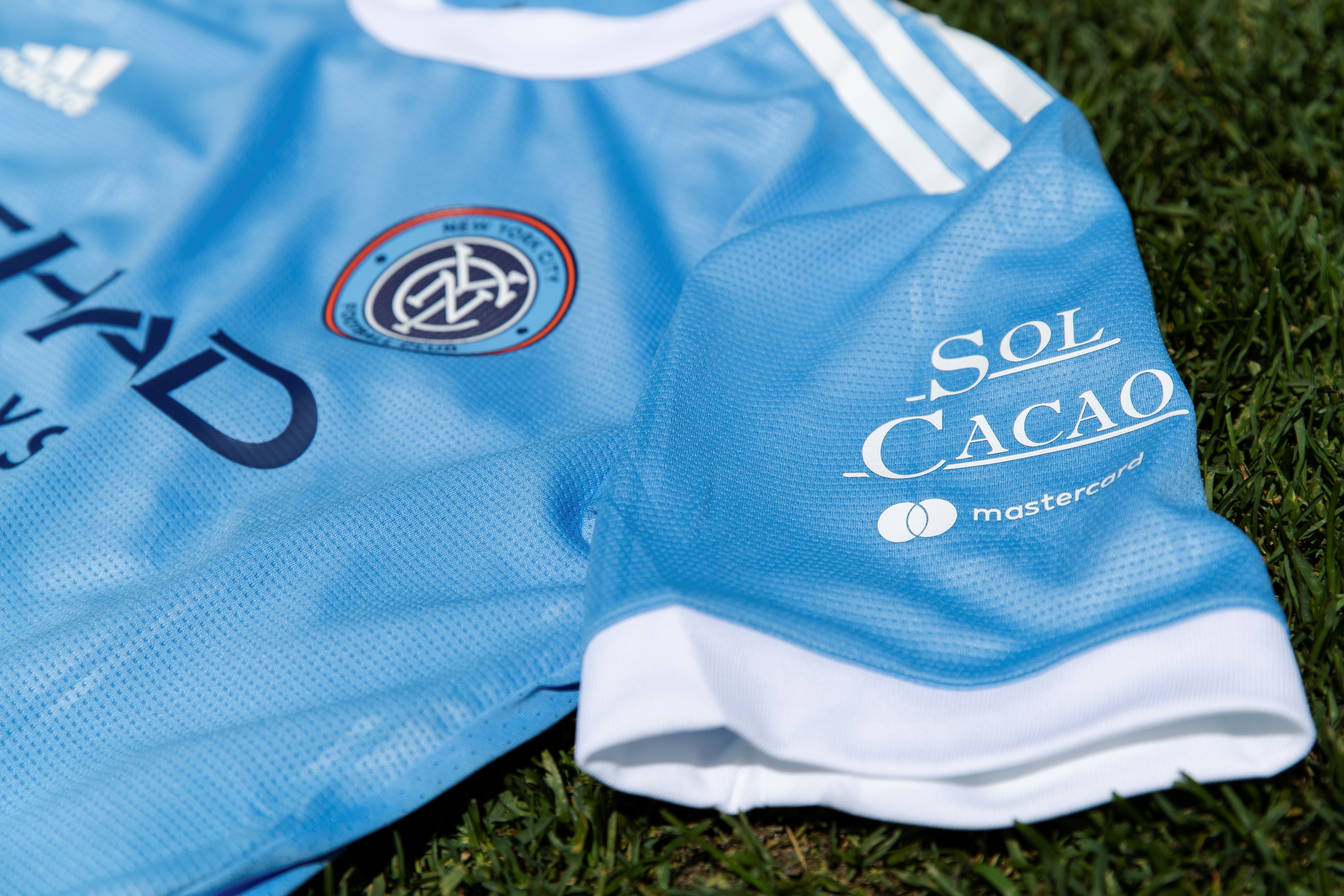 The logo of Bronx craft chocolate company Sol Cacao is shown on the left sleeve of Major League Soccer's New York City Football Club's jersey in this undated handout photo. NYCFC.COM/Handout via REUTERS