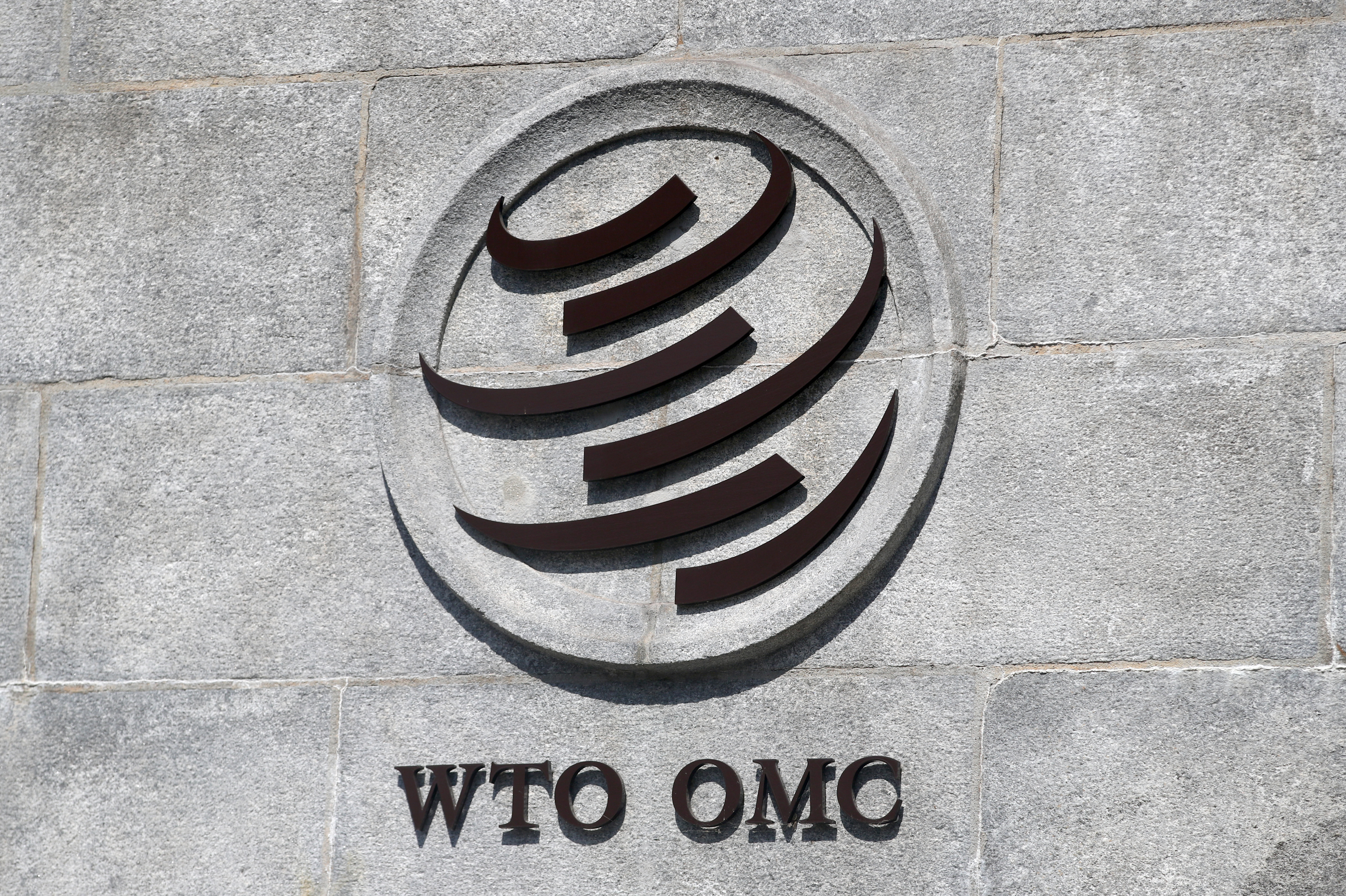 A logo is pictured on the headquarters of the World Trade Organization (WTO) in Geneva, Switzerland, June 2, 2020. REUTERS/Denis Balibouse