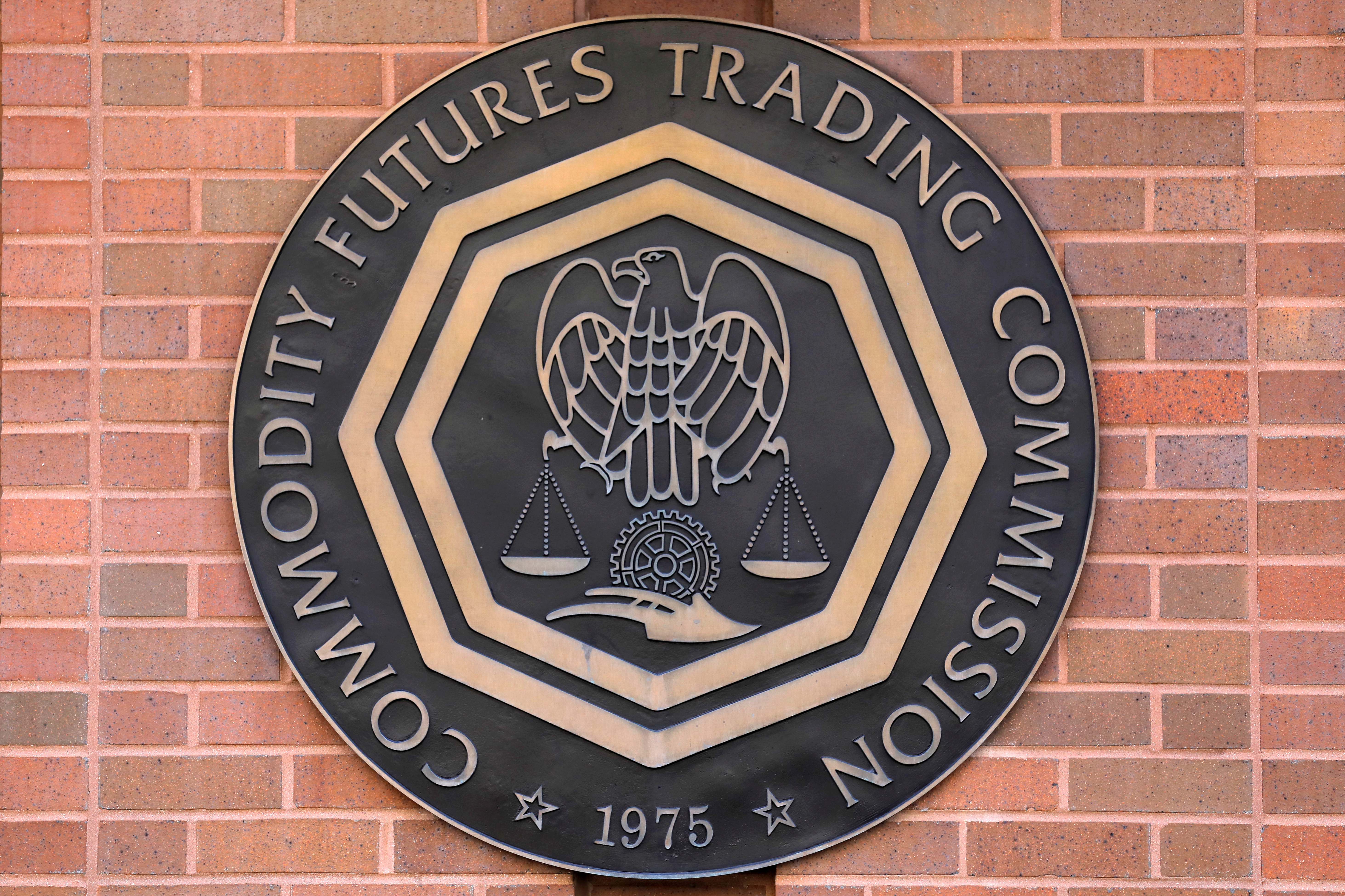 Signage is seen outside of the U.S. Commodity Futures Trading Commission (CFTC) in Washington, D.C., U.S., August 30, 2020. REUTERS/Andrew Kelly/File Photo