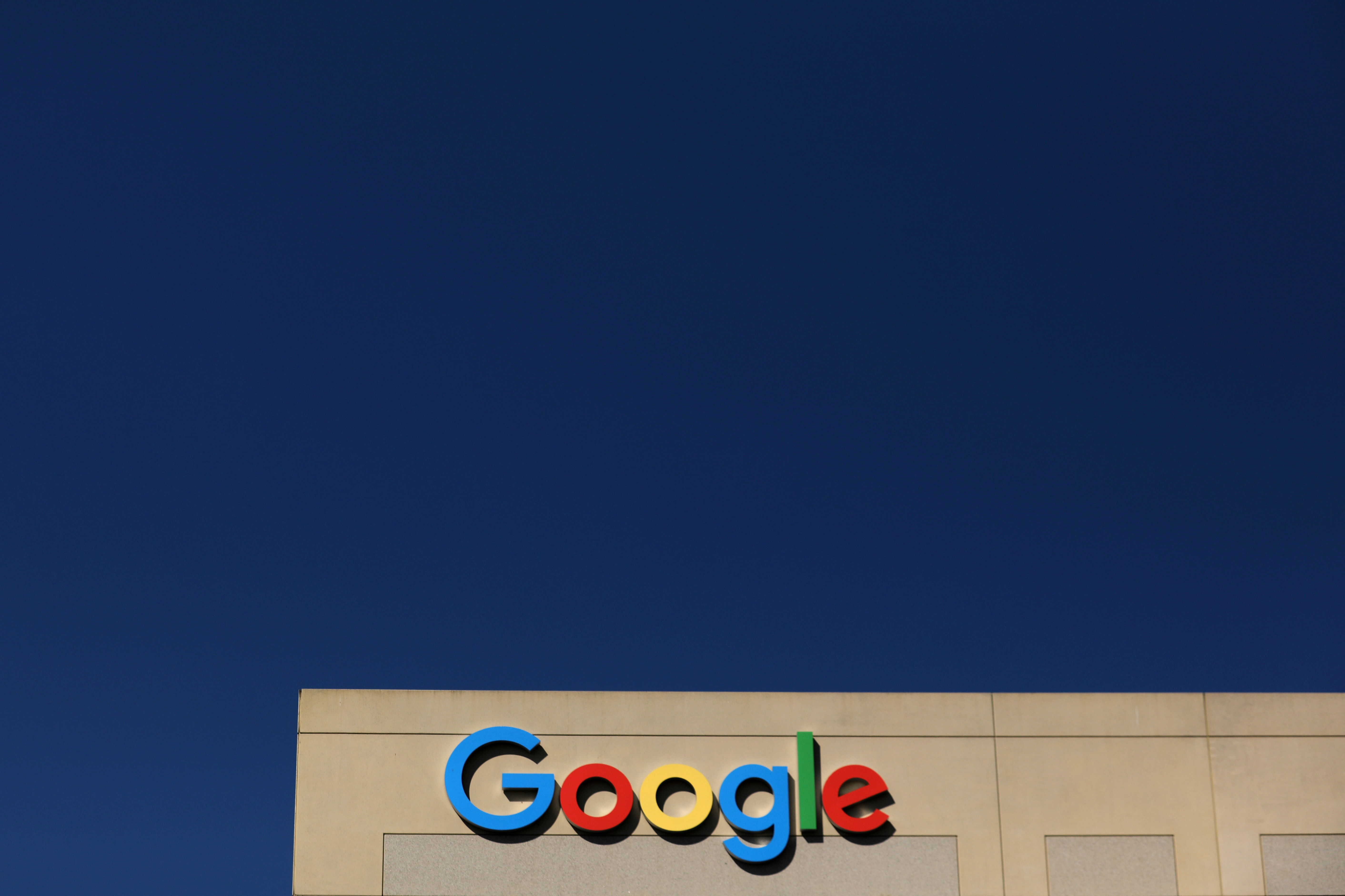 File photo: The Google logo is pictured atop an office building in Irvine, California, U.S. August 7, 2017.   REUTERS/Mike Blake