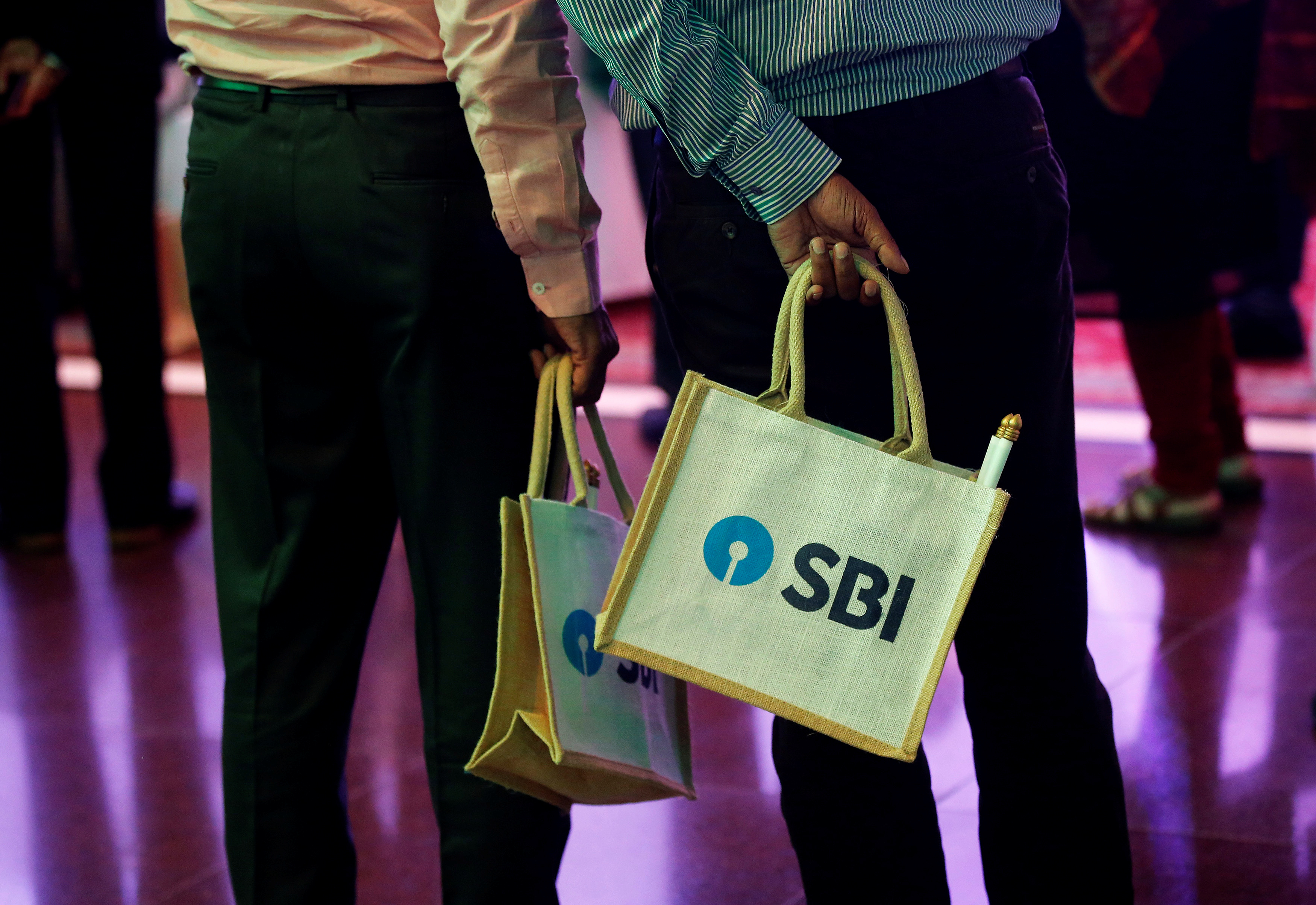 The State Bank of India (SBI) logo is seen on bags carried by participants during a news conference in Mumbai, India October 30,  2017. REUTERS/Shailesh Andrade/File Photo