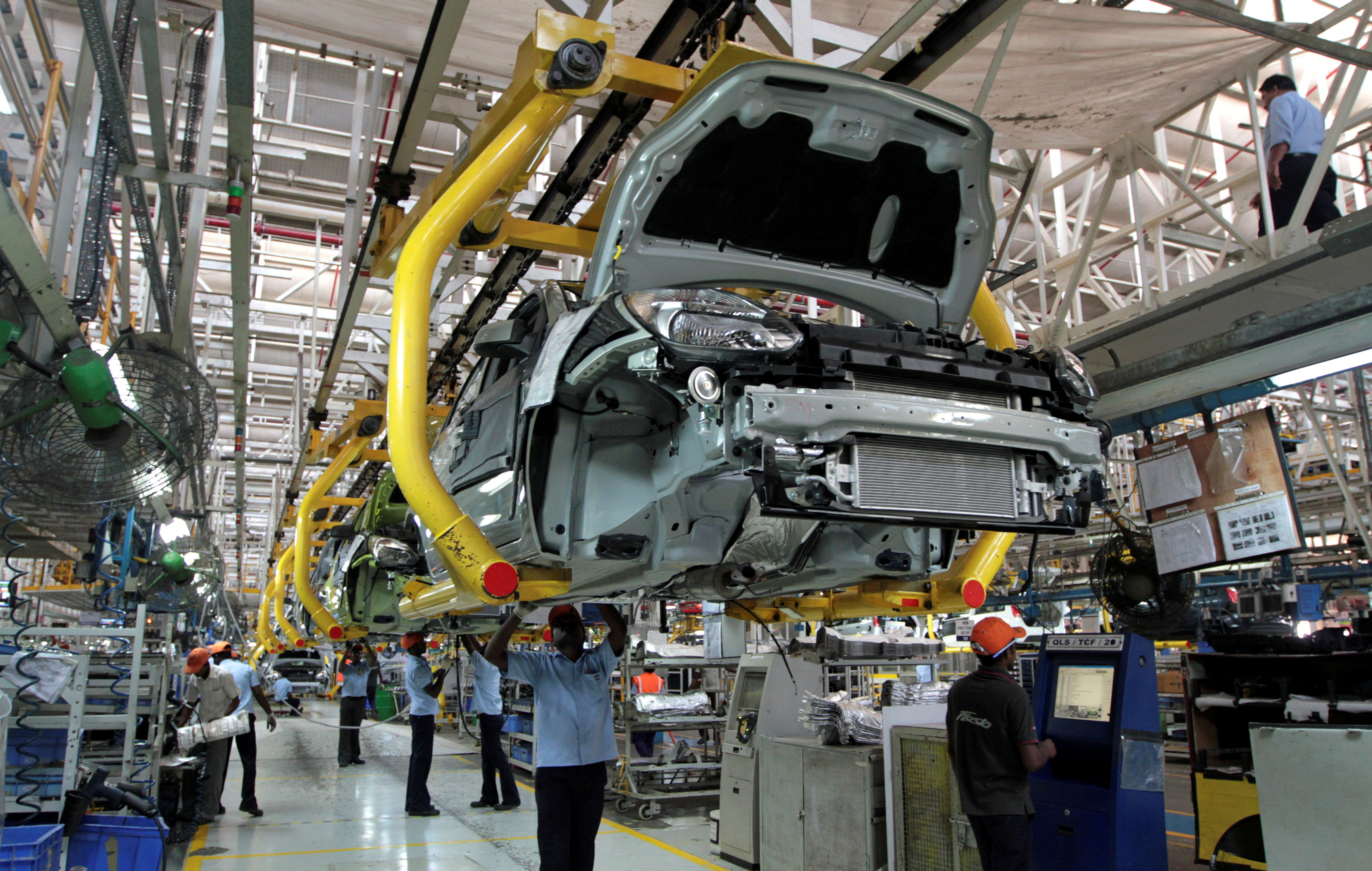 Workers assemble Ford cars at a plant of Ford India in Chengalpattu on the outskirts of Chennai, India March 5, 2012. REUTERS/Babu/File Photo
