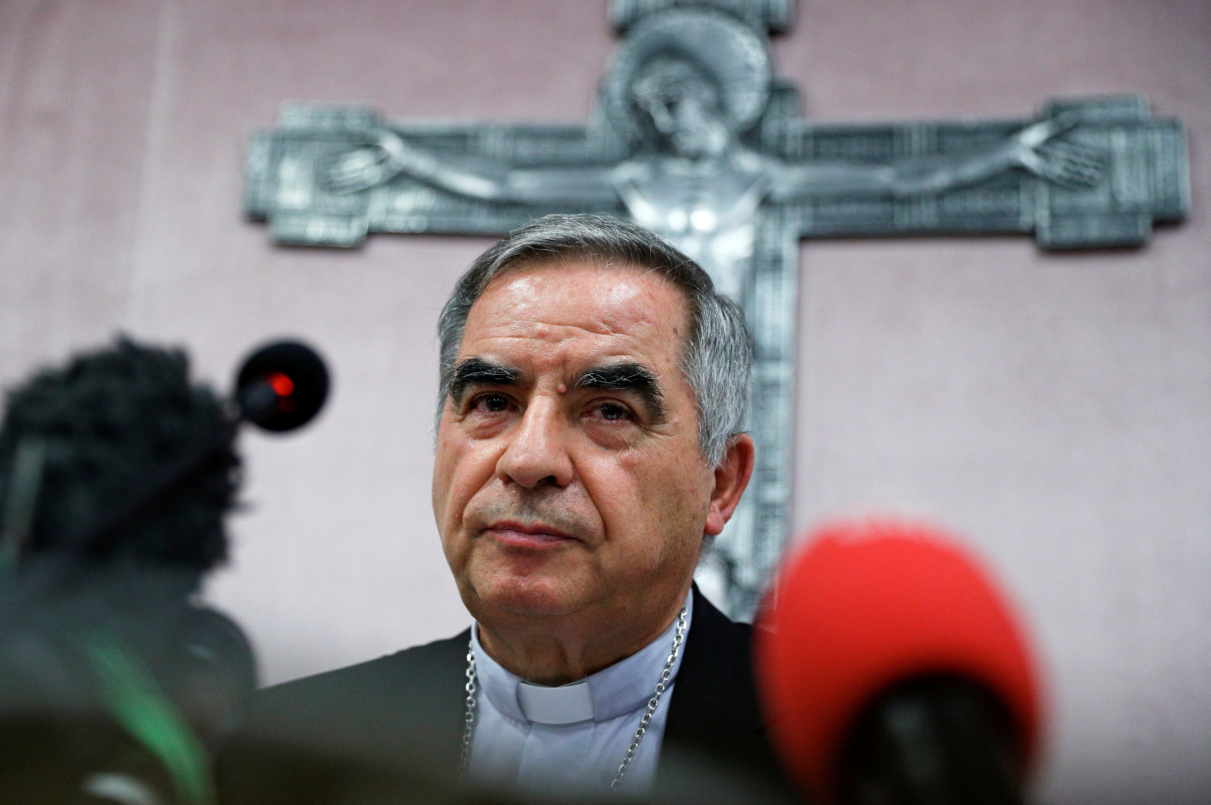 Cardinal Giovanni Angelo Becciu, who has been caught up in a real estate scandal, pauses as he speaks to the media a day after he resigned suddenly and gave up his right to take part in an eventual conclave to elect a pope, near the Vatican, in Rome, Italy, September 25, 2020. REUTERS/Guglielmo Mangiapane/File Photo