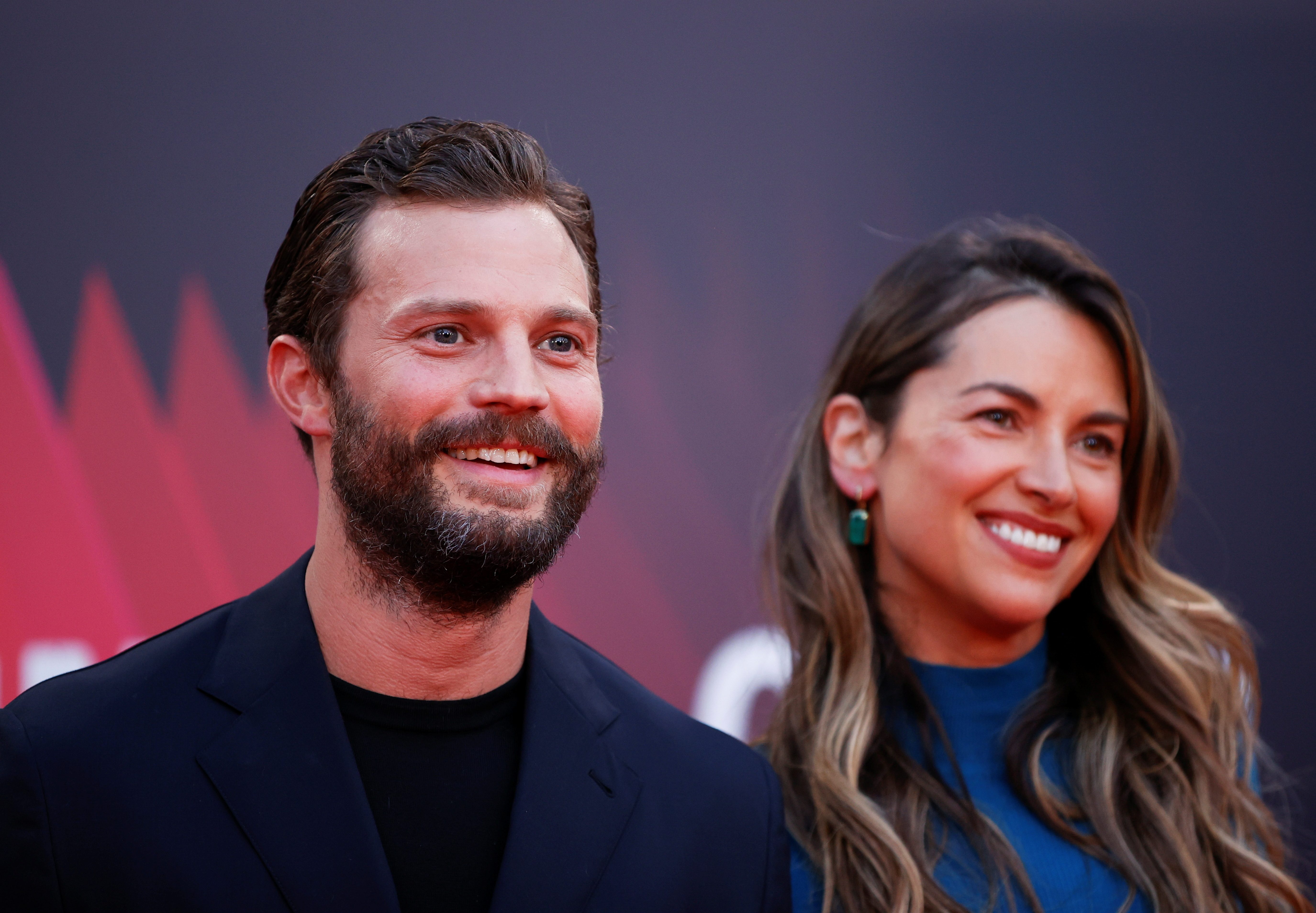 Cast member Jamie Dornan and Amelia Warner arrive at a screening of the film