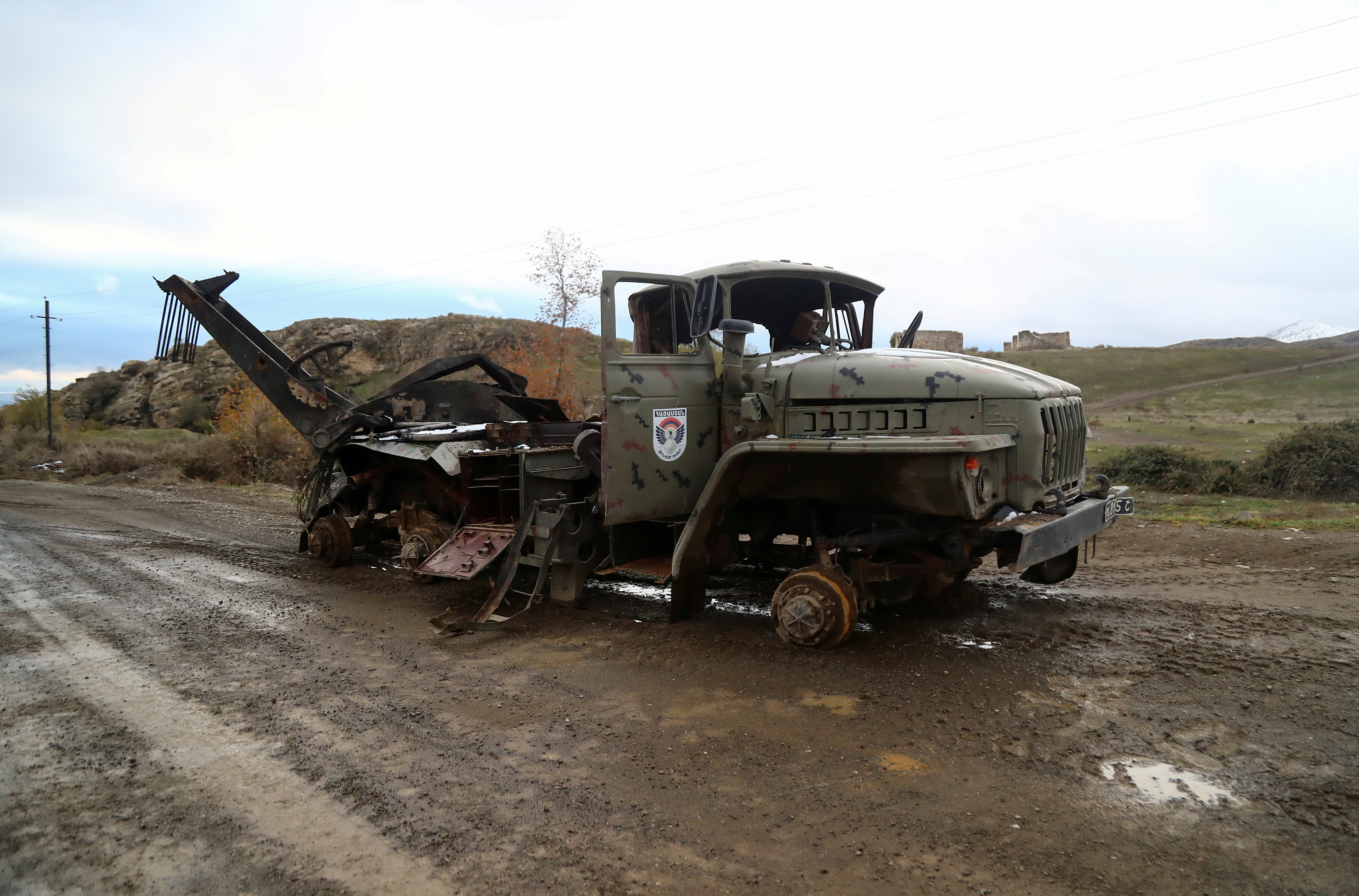A view shows a damaged truck belonging to ethnic Armenian forces in an area that came under the control of Azerbaijan's troops following a military conflict over Nagorno-Karabakh, in Jabrayil District, December 7, 2020. REUTERS/Aziz Karimov