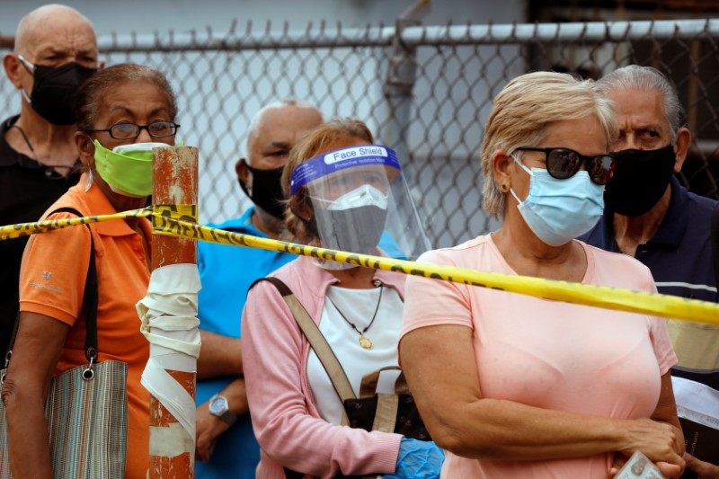 People wait on a street outside the Regional Government Health Corporation turned into a mass vaccination centre to receive their first dose of Russia's Sputnik V vaccine against the coronavirus disease (COVID-19), in Maracay, Venezuela June 8, 2021. REUTERS/Leonardo Fernandez Viloria