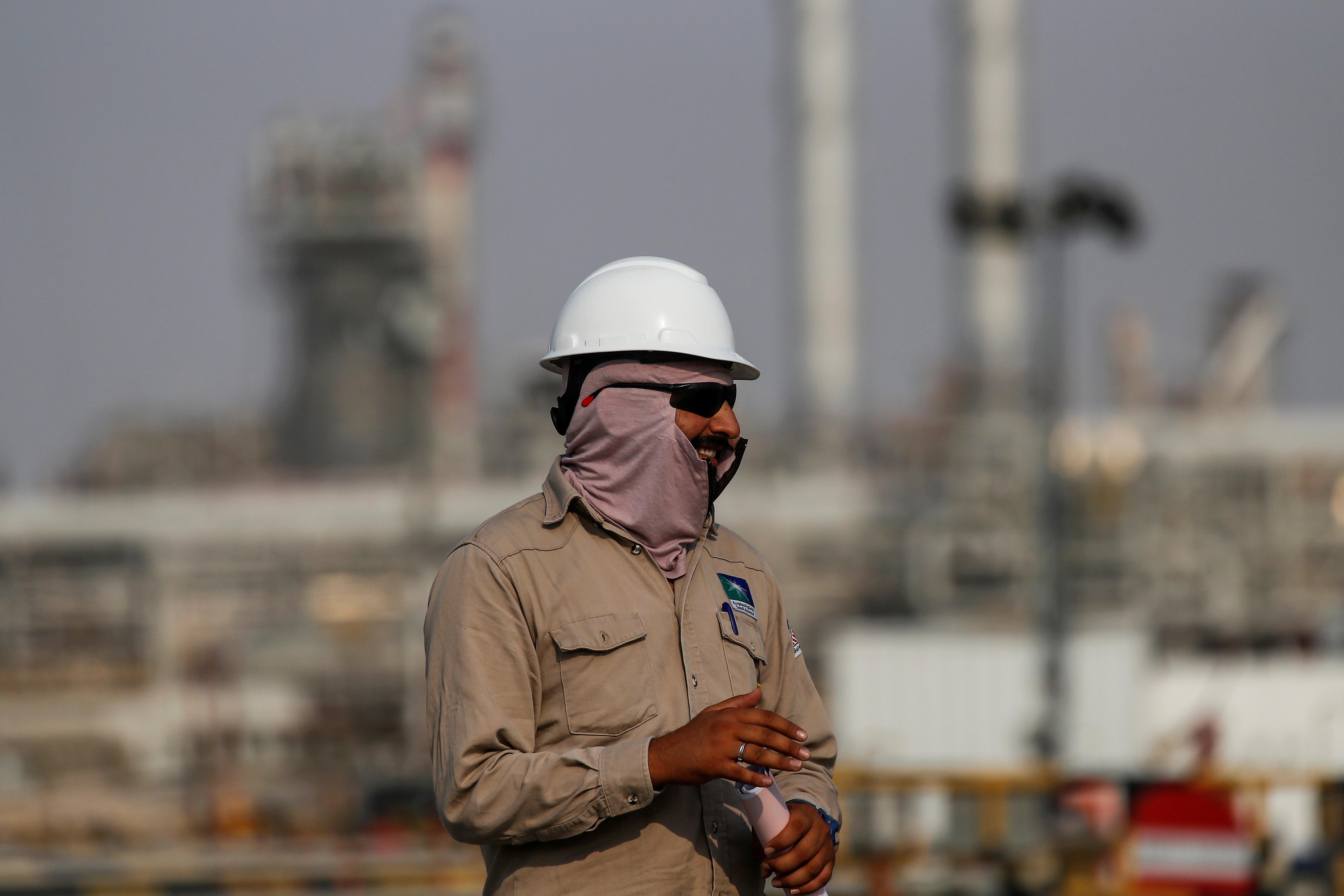 An employee looks on at Saudi Aramco oil facility in Abqaiq, Saudi Arabia October 12, 2019. REUTERS/Maxim Shemetov