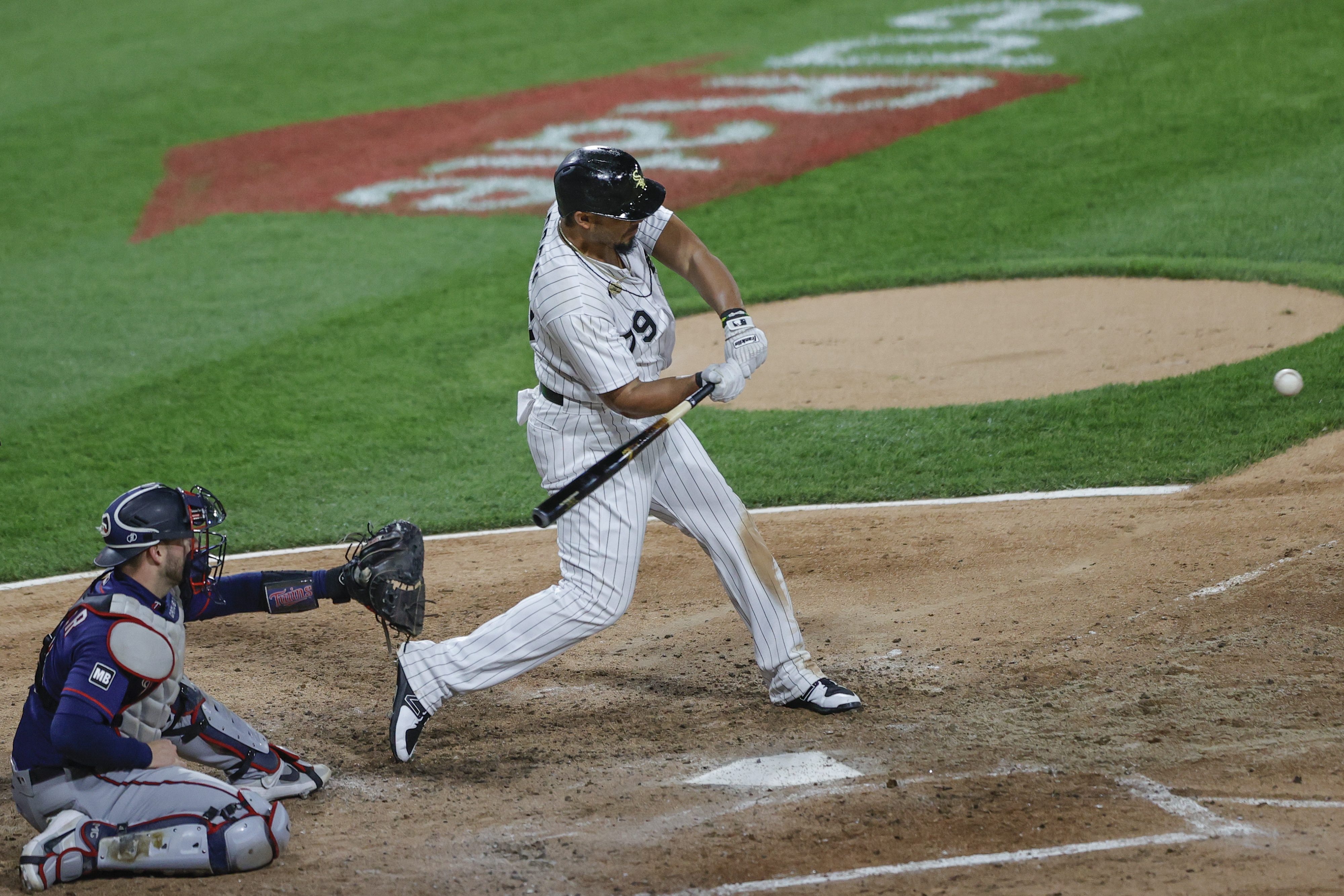 May 12, 2021; Chicago, Illinois, USA; Chicago White Sox first baseman Jose Abreu (79) hits a two-run single against the Minnesota Twins during the fourth inning at Guaranteed Rate Field. / Kamil Krzaczynski-USA TODAY Sports
