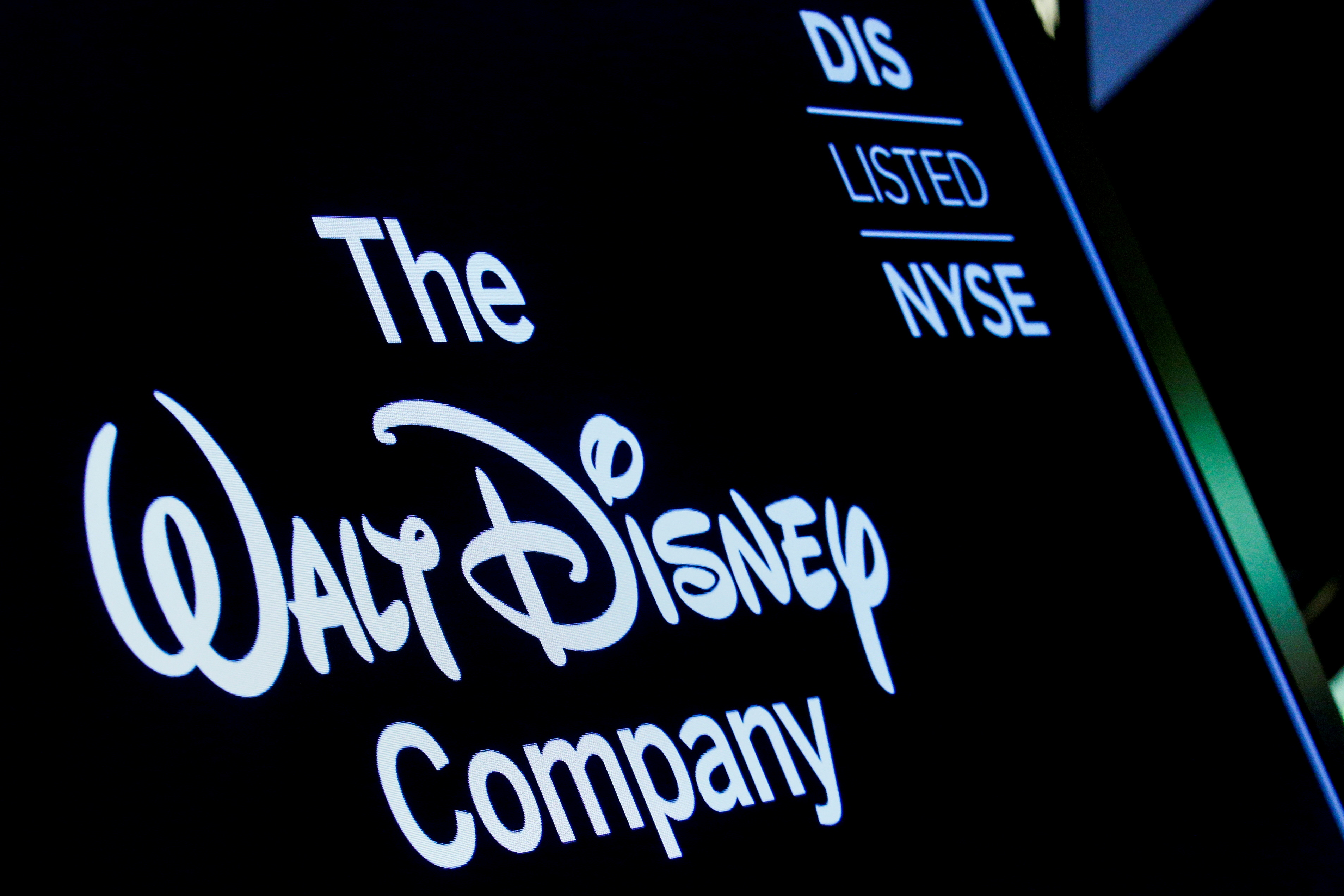 A screen shows the logo of the Walt Disney Company on the floor of the New York Stock Exchange in New York, U.S., December 14, 2017. REUTERS/Brendan McDermid