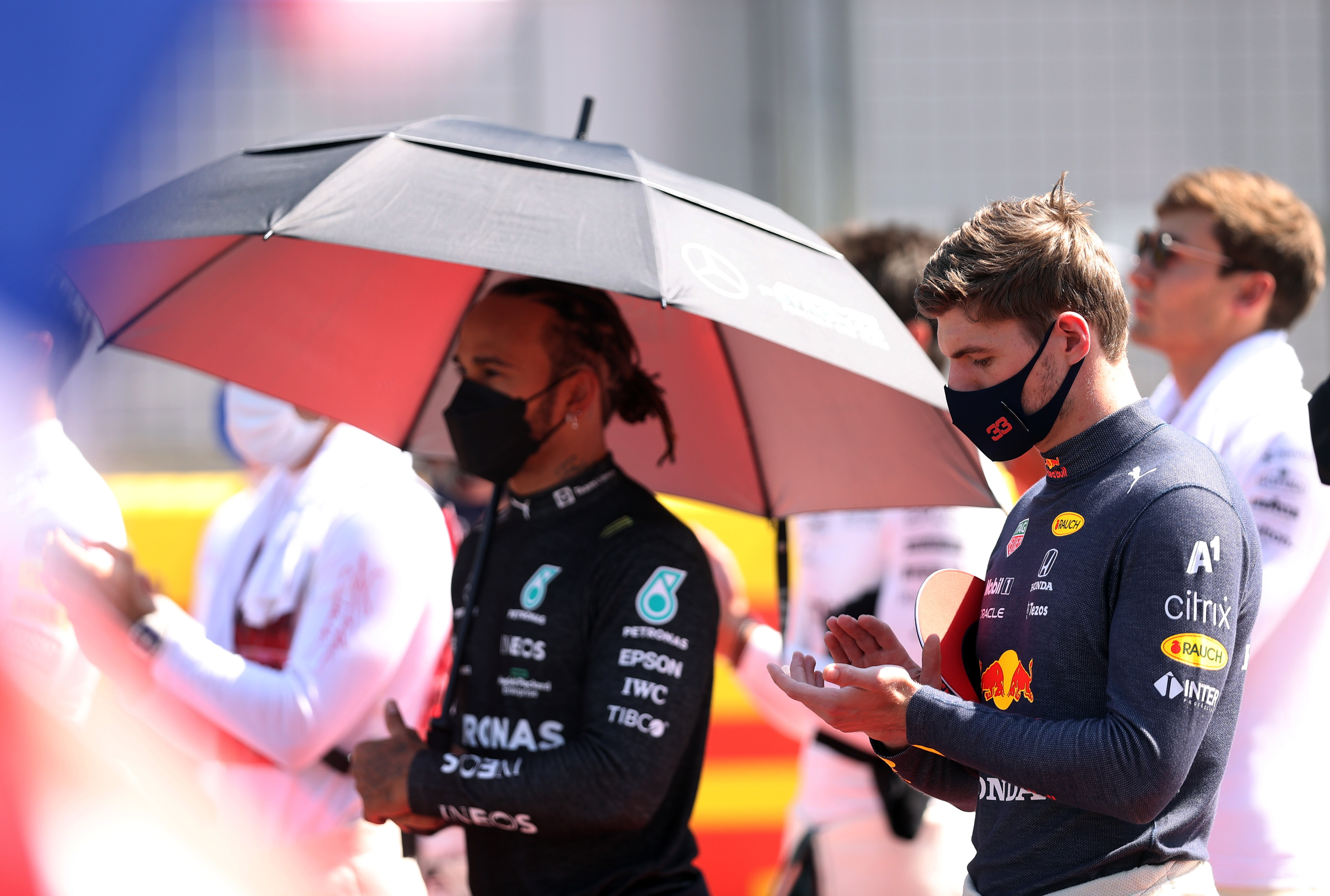 Formula One F1 - British Grand Prix - Silverstone Circuit, Silverstone, Britain - July 18, 2021 Mercedes' Lewis Hamilton and Red Bull's Max Verstappen before the race Pool via REUTERS/Lars Baron/File Photo