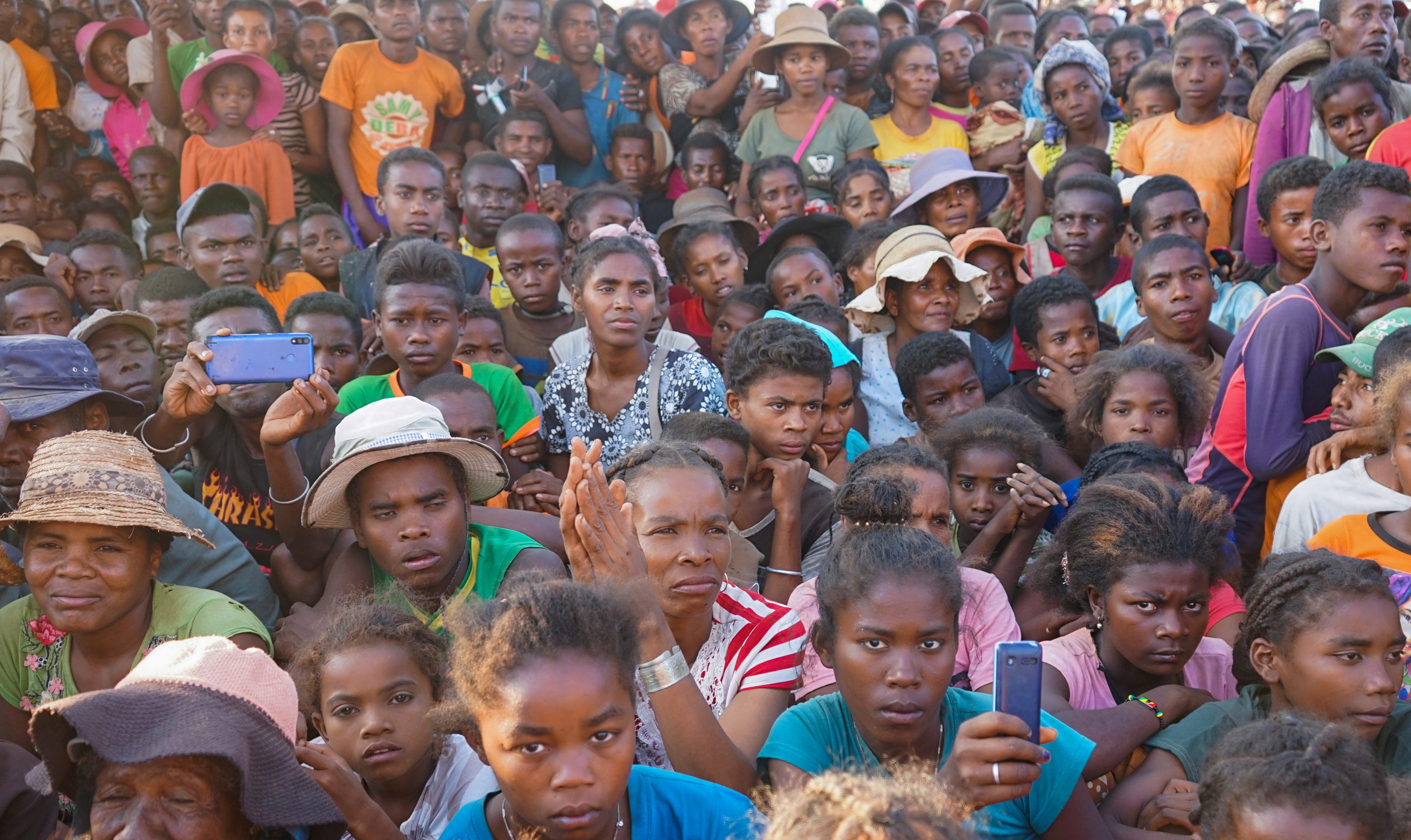 Residents attend the launch of the Titre Vert project (Green Title project) allowing villagers and refugees to utilise land in Fort-Dauphin, southern Madagascar September 30, 2021. REUTERS/Joel Kouam