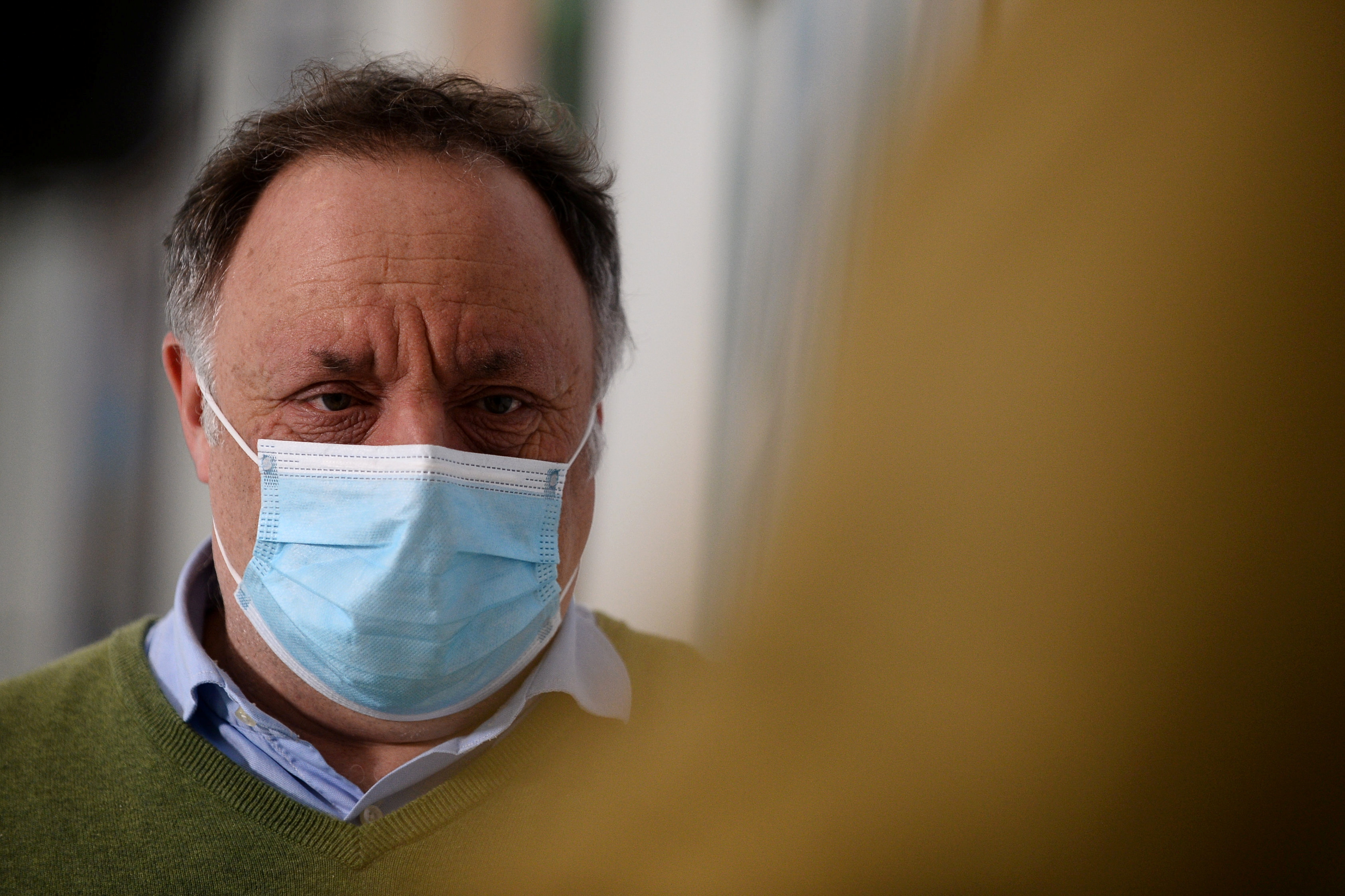 Belgian virologist Marc Van Ranst, wearing a protective face mask, talks during an interview with Reuters in Leuven, amid the coronavirus disease  (COVID-19) outbreak in Belgium, February 2, 2021.REUTERS/Johanna Geron