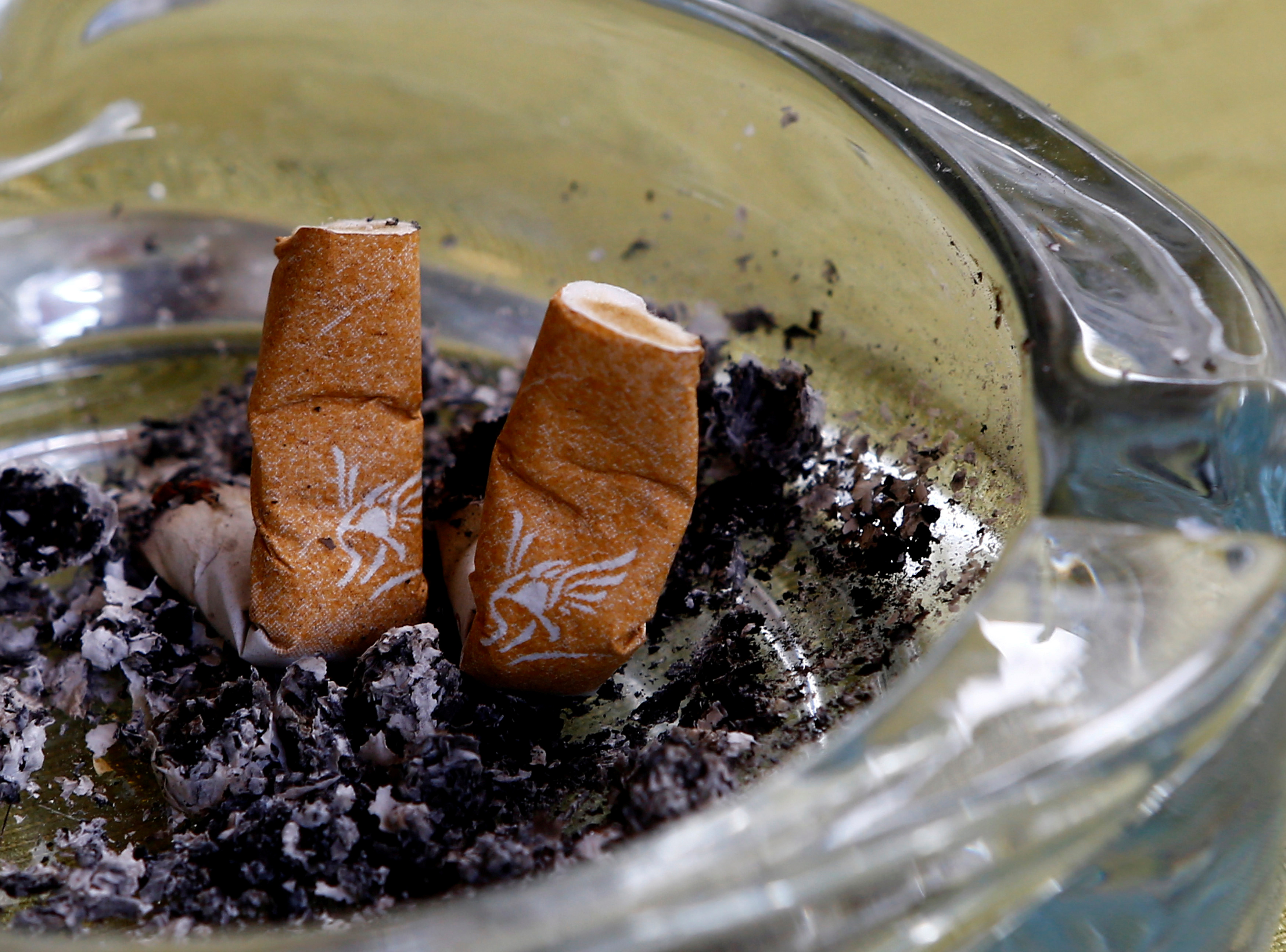 An illustration picture shows discarded Gauloises cigarette butts in an ashtray in a coffee house in Vienna, Austria, May 12, 2017.  REUTERS/Leonhard Foeger/Illustration