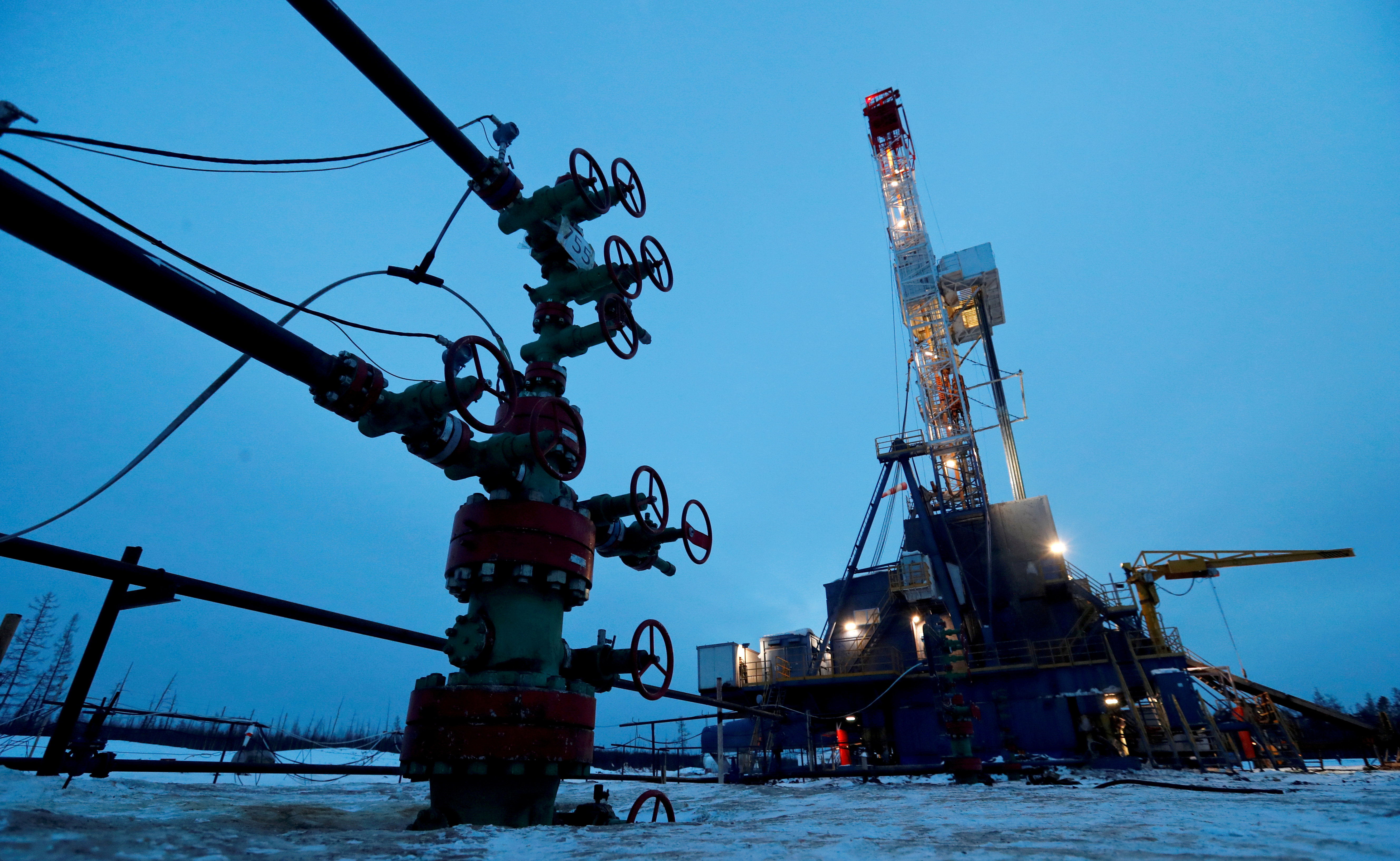 A well head and drilling rig in the Yarakta oilfield, owned by Irkutsk Oil Company (INK), in the Irkutsk region, Russia, March 11, 2019. REUTERS/Vasily Fedosenko/File Photo