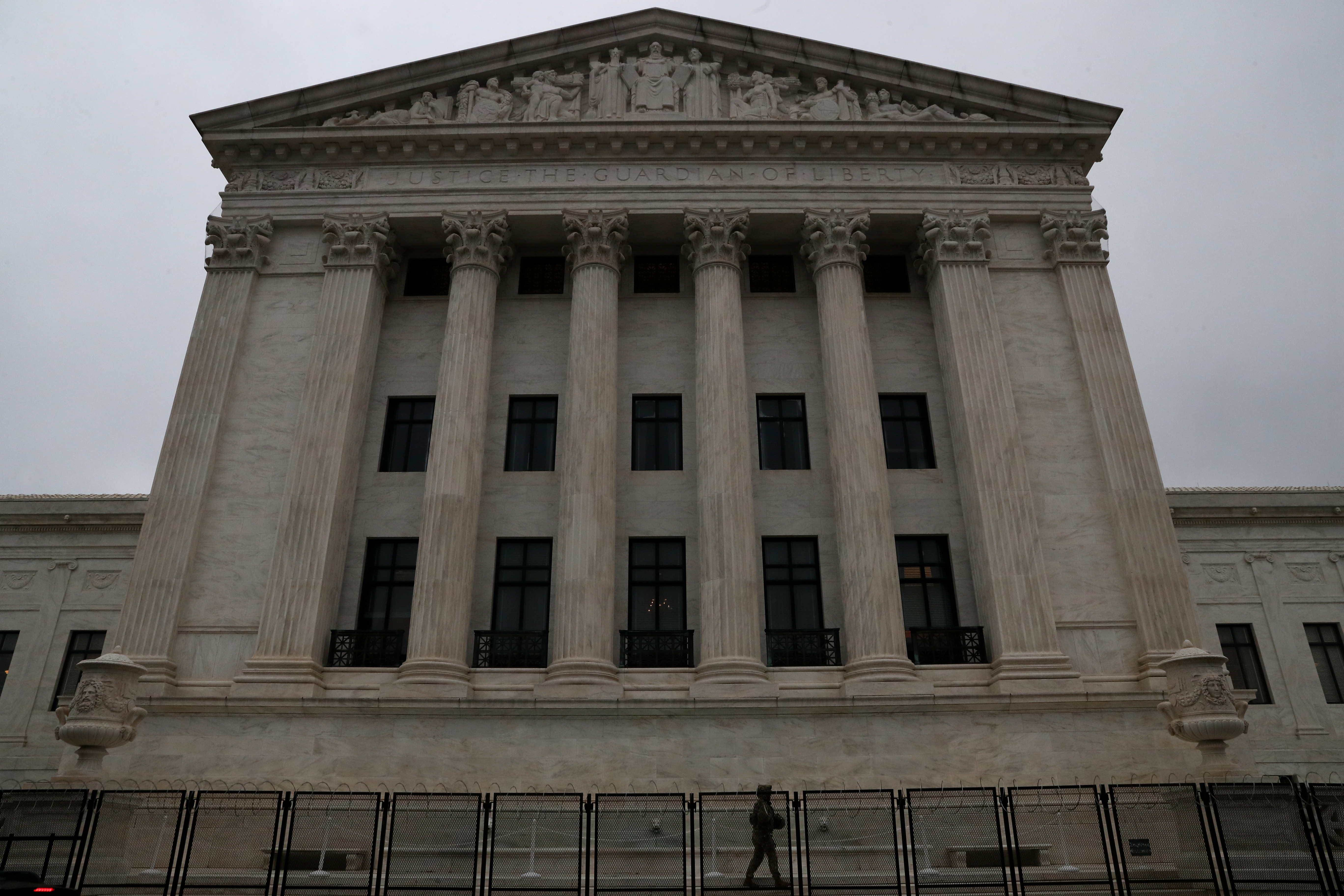 A member of the U.S. National Guard walks the perimeter behind the U.S. Supreme Court near the U.S. Capitol Building on the third day of the second impeachment trial of former U.S. President Donald Trump over his role in the January 6 attack on the U.S. Capitol Building in Washington, U.S., February 11, 2021. Picture taken February 11, 2021. REUTERS/Leah Millis