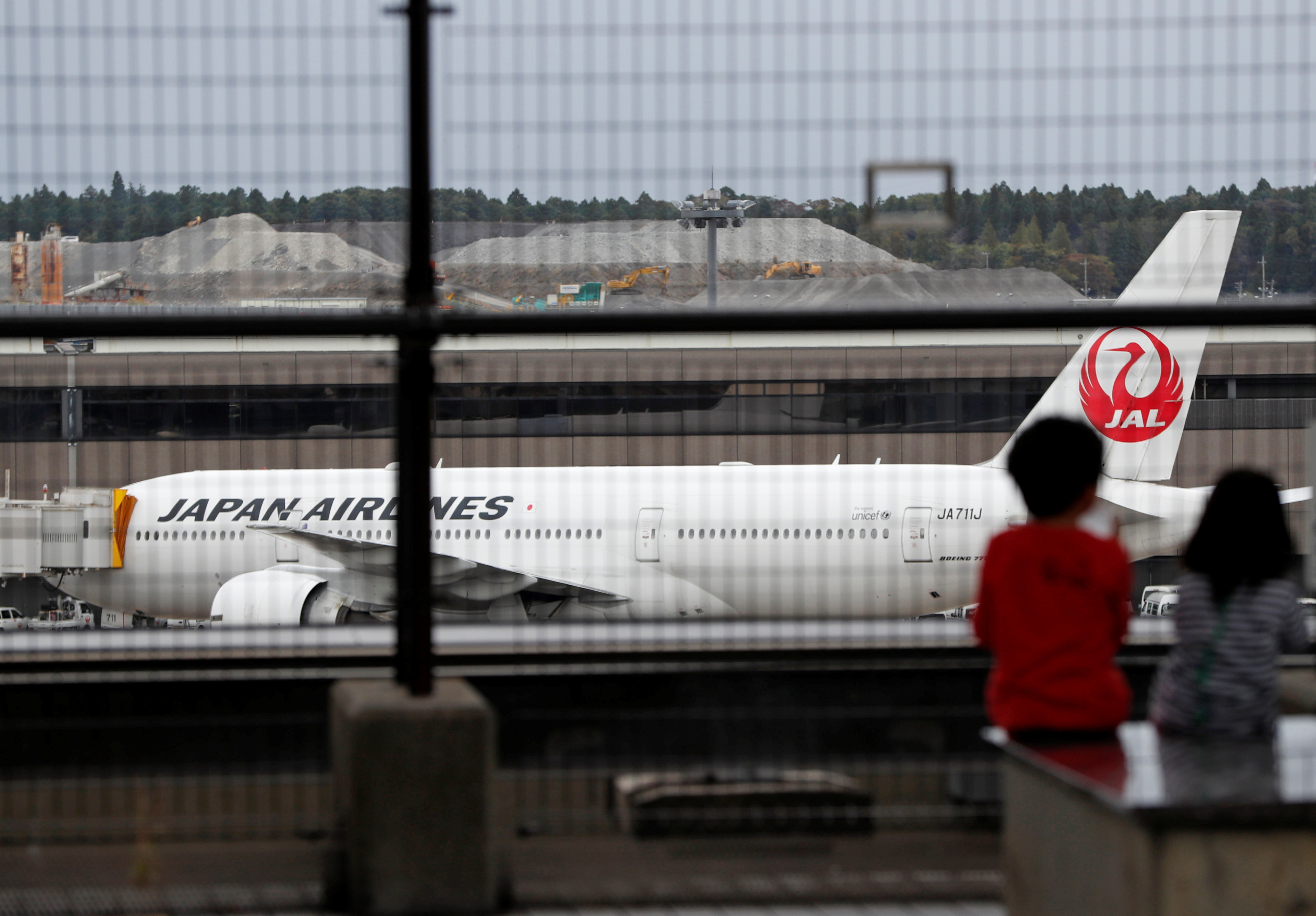 A Japan Airlines (JAL) airplane is seen at Narita international airport, where there are fewer passengers than usual amid the coronavirus disease (COVID-19) outbreak, in Narita, east of Tokyo, Japan November 2, 2020. REUTERS/Issei Kato