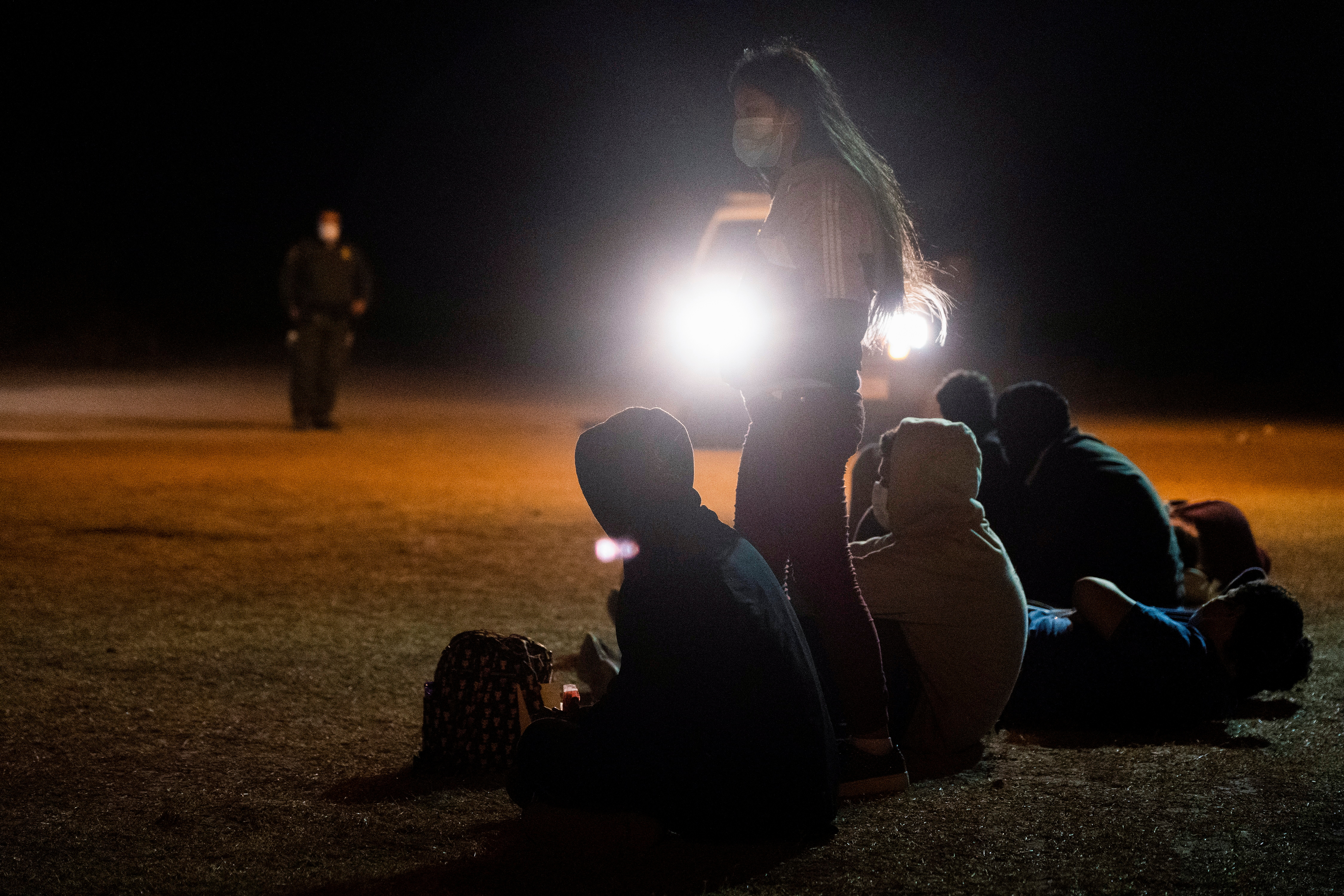 Unaccompanied minor migrants wait to be transported by the U.S. Border Patrols after crossing the Rio Grande River into the United States from Mexico in La Joya, Texas, U.S., April 7, 2021. REUTERS/Go Nakamura