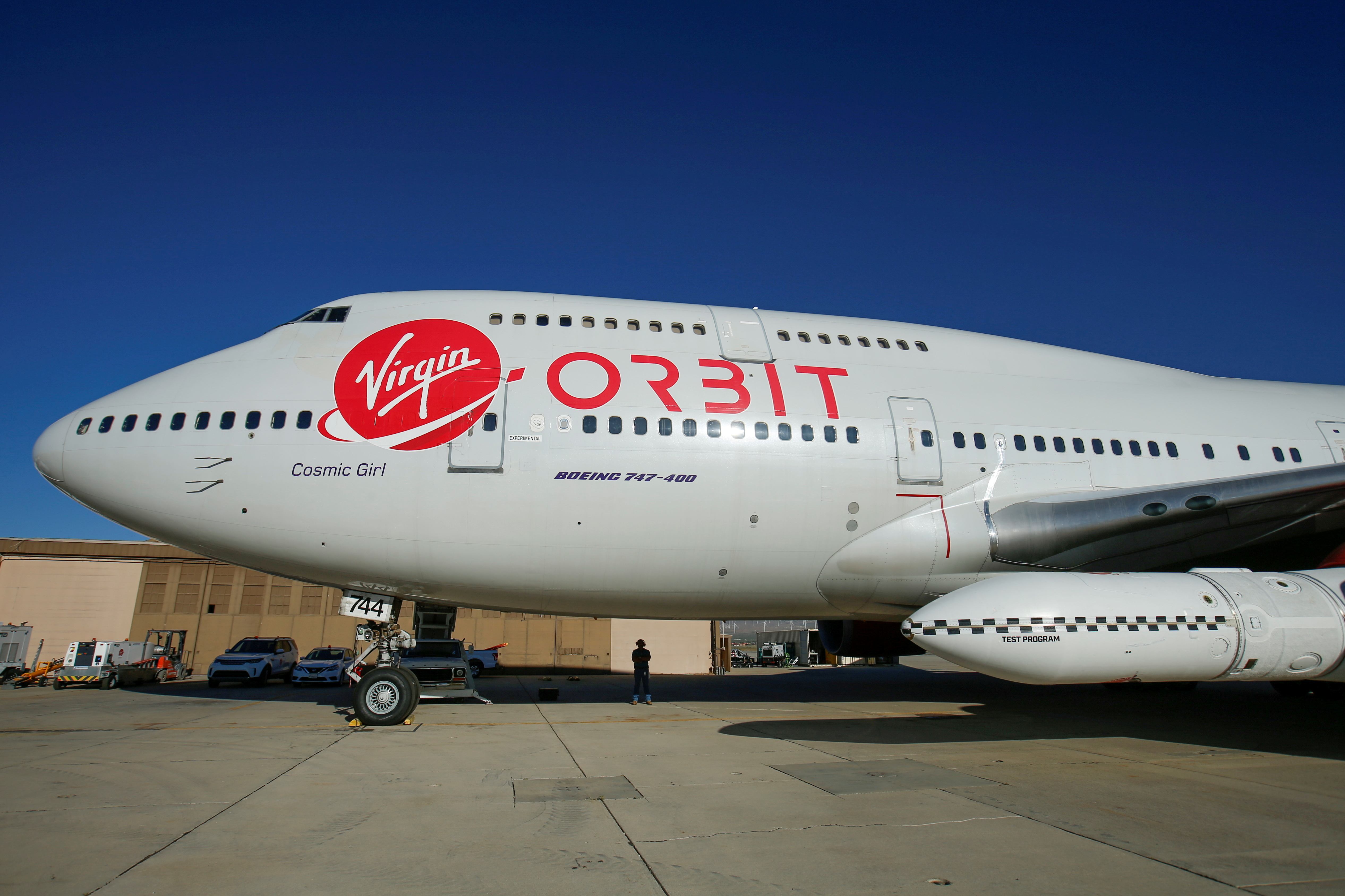 Richard Branson's Virgin Orbit, with a rocket underneath the wing of a modified Boeing 747 jetliner, prior to its takeoff on a key drop test of its high-altitude launch system for satellites from Mojave, California, U.S. July 10, 2019.  REUTERS/Mike Blake/File Photo
