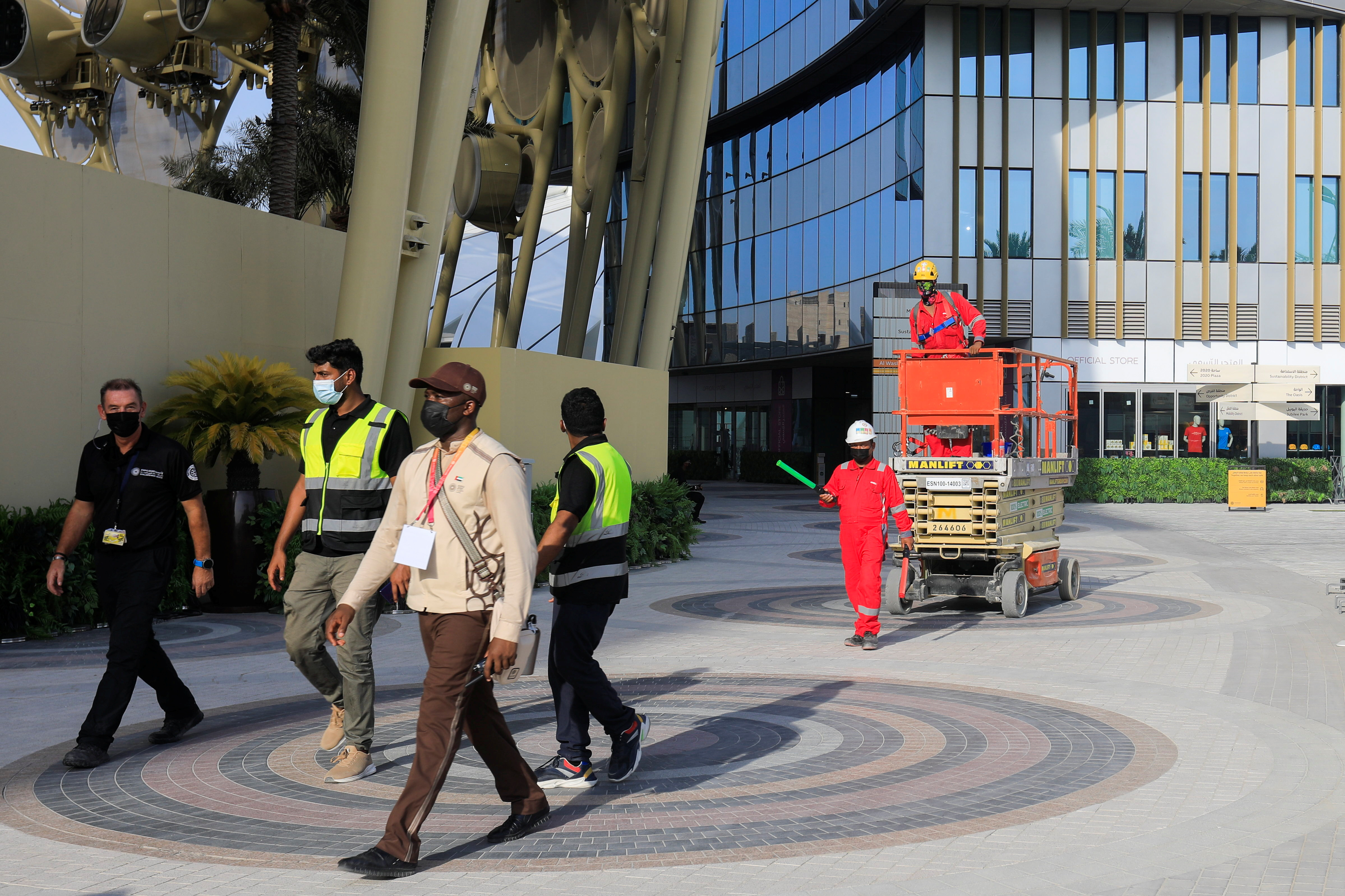 Workers walk at the Expo 2020 site ahead of the opening ceremony in Dubai, United Arab Emirates, September 30, 2021. REUTERS/Rula Rouhana
