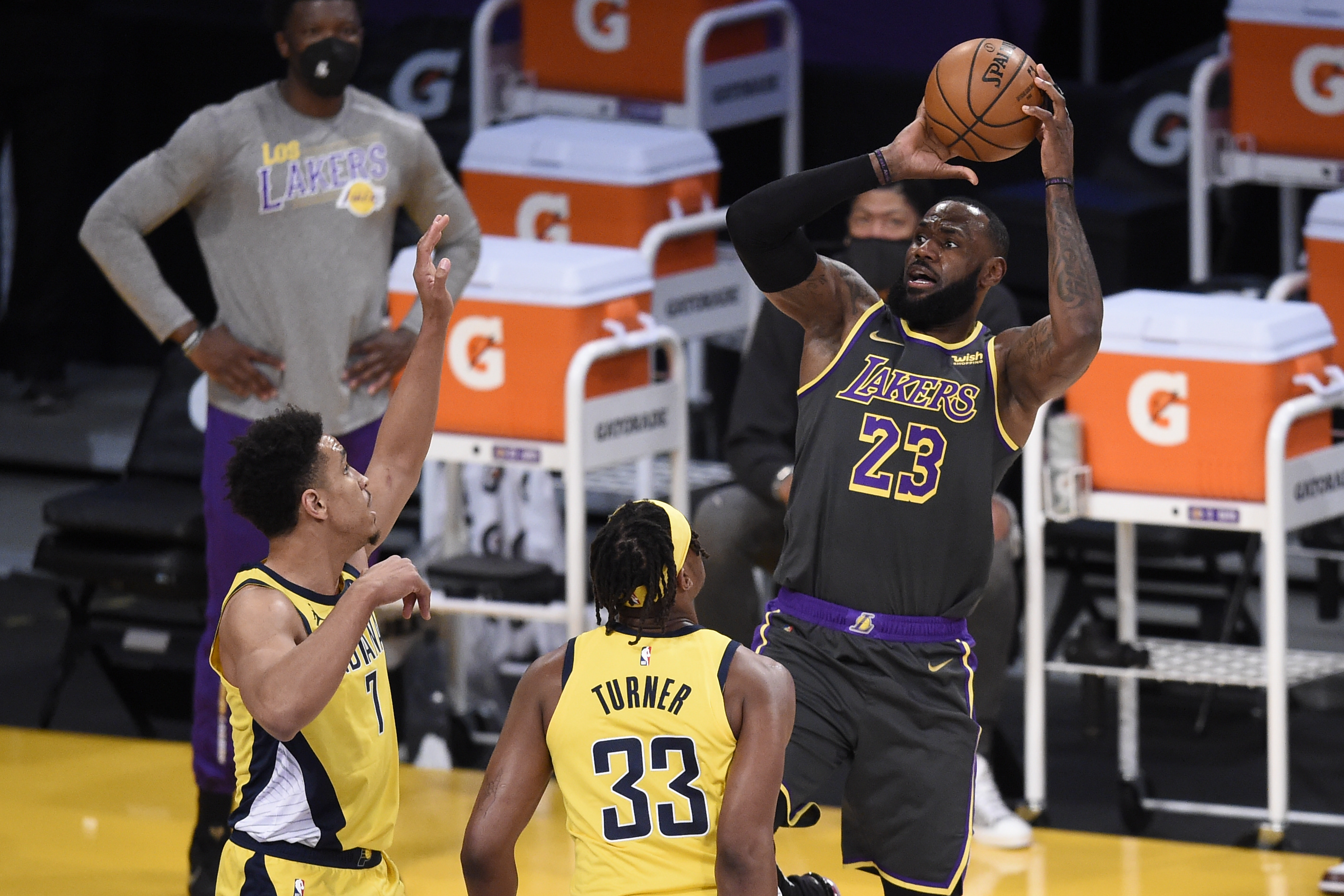 Mar 12, 2021; Los Angeles, California, USA; Los Angeles Lakers forward LeBron James (23) shoots while Indiana Pacers guard Malcolm Brogdon (7) defends during the first half at Staples Center. Mandatory Credit: Kelvin Kuo-USA TODAY Sports