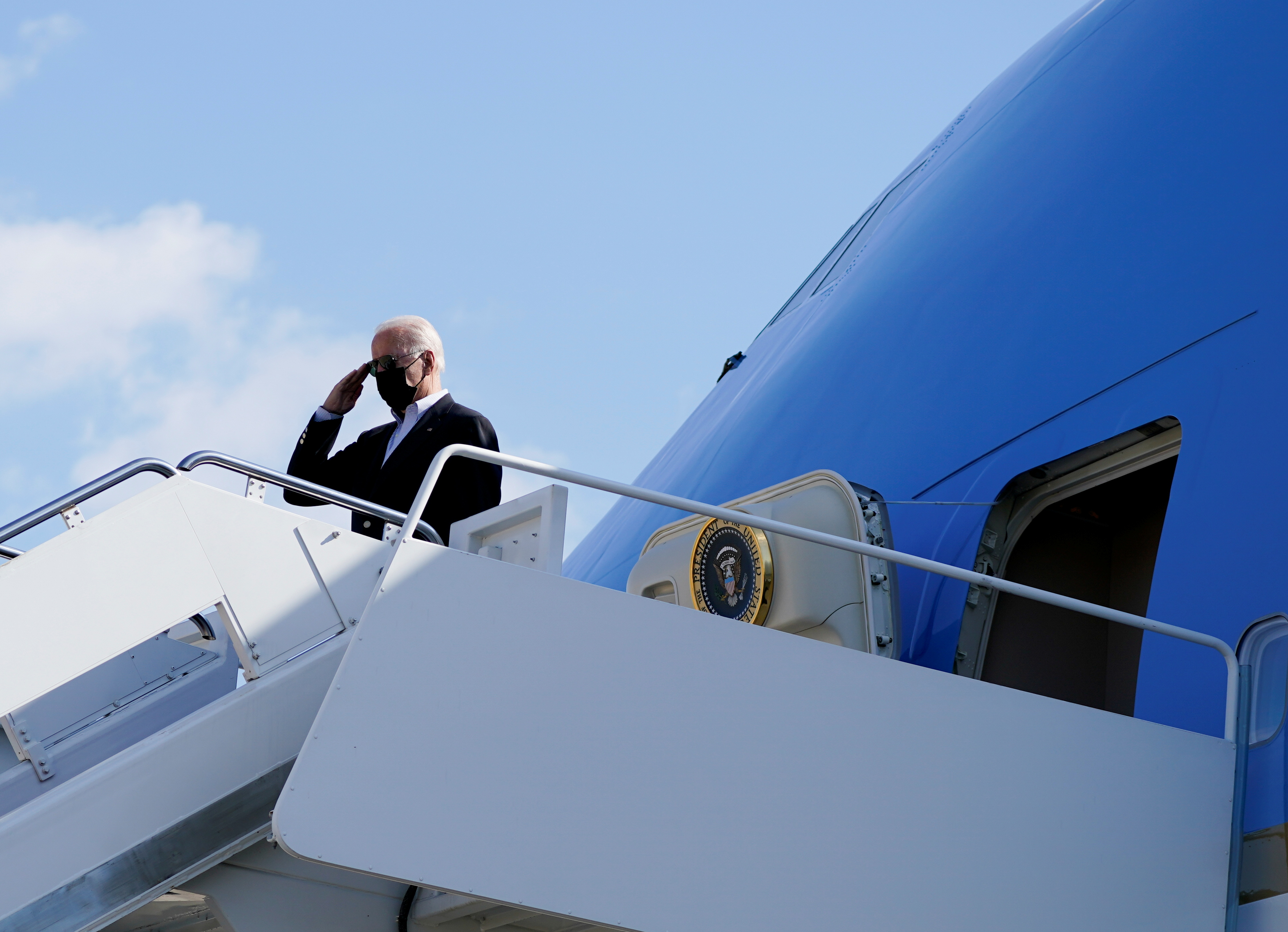 U.S. President Joe Biden salutes as he boards Air Force One to travel to New York and New Jersey to tour the hurricane-affected areas, from Joint Base Andrews, Maryland, U.S. September 7, 2021. REUTERS/Elizabeth Frantz