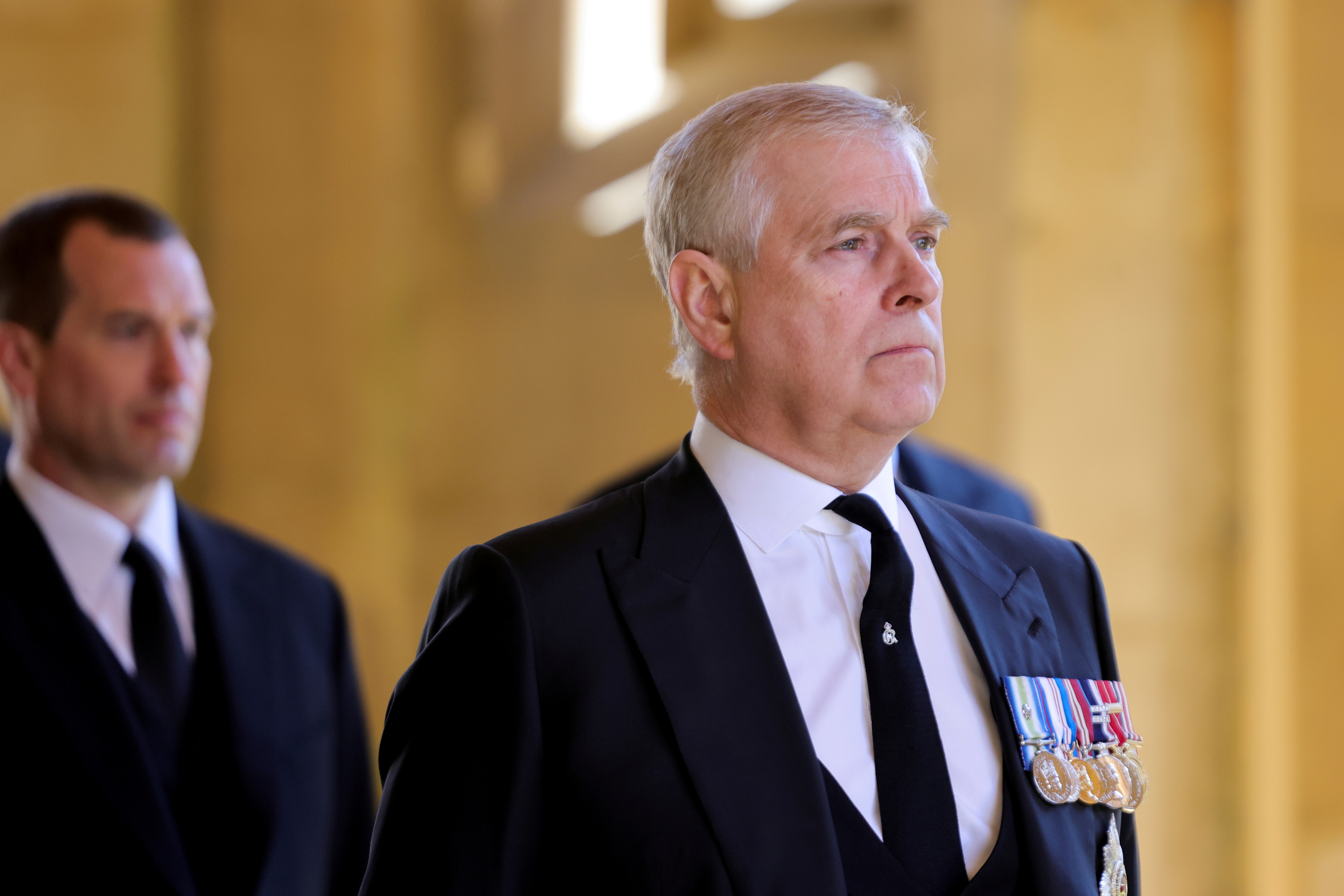 Britain's Britain's Prince Andrew, Duke of York, looks on during the funeral of Britain's Prince Philip, husband of Queen Elizabeth, who died at the age of 99, on the grounds of Windsor Castle in Windsor, Britain, April 17, 2021. Chris Jackson/Pool via REUTERS/File Photo