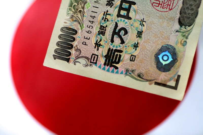 A Japan yen note is seen in this illustration photo taken June 1, 2017. REUTERS/Thomas White/Illustration/File Photo