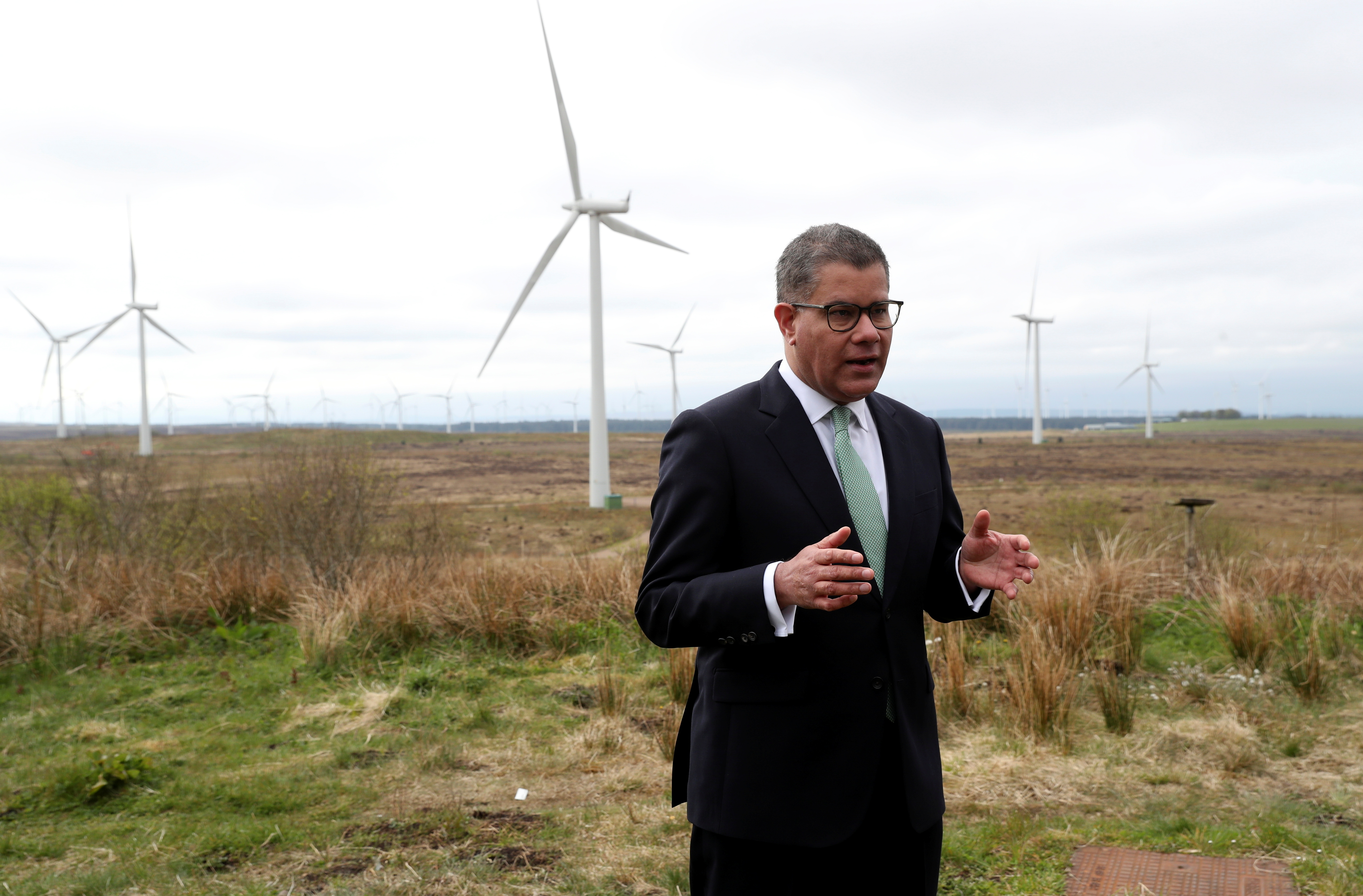COP26 President Alok Sharma rehearses a speech at Whitelee Windfarm, with six months to go until the U.N. Climate Change Conference, just outside Glasgow, Scotland, Britain, May 14, 2021. REUTERS/Russell Cheyne/Pool