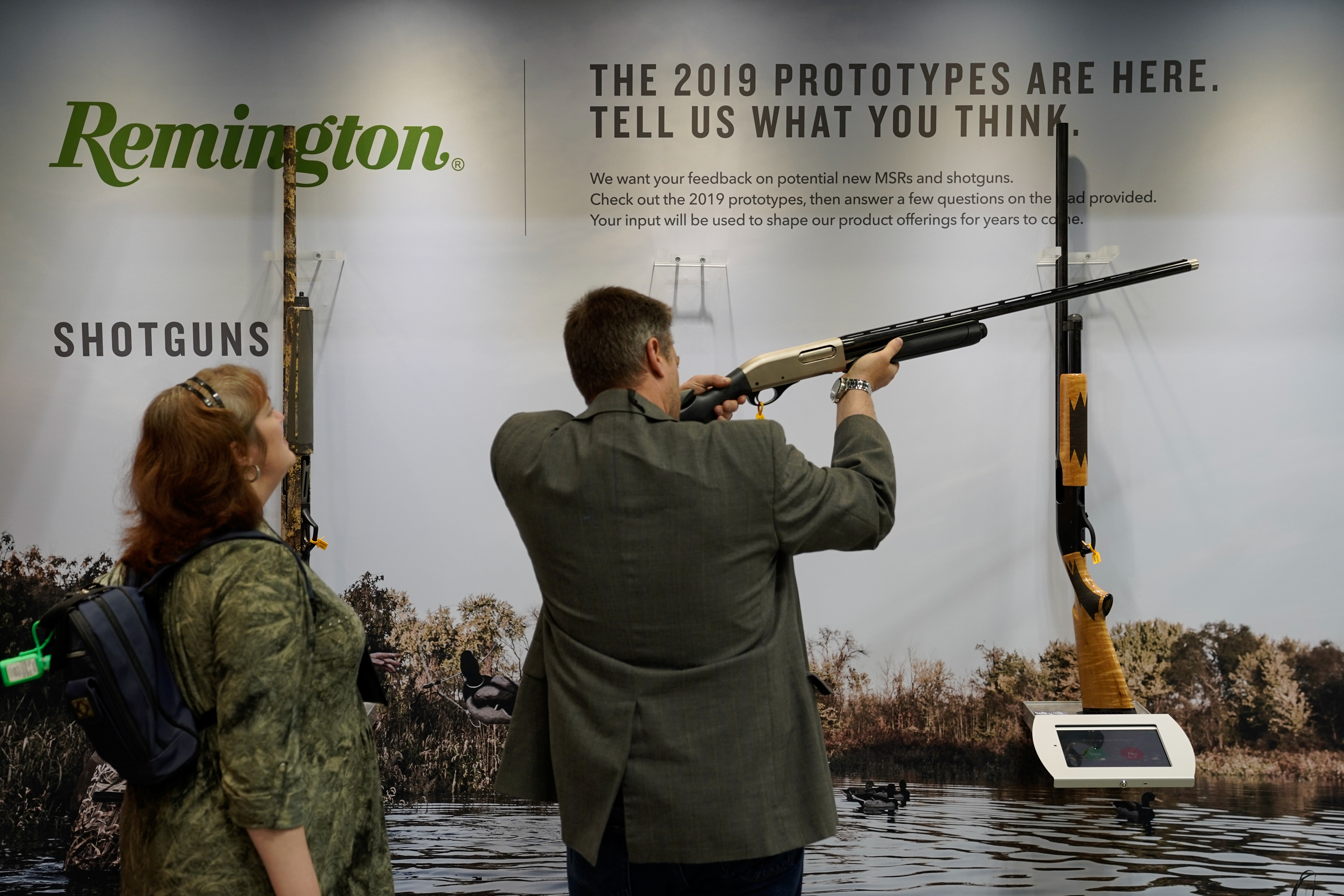 Attendees examine a Remington shotgun at the National Rifle Association's (NRA) annual meeting, in Indianapolis, Indiana, U.S., April 28, 2019.  REUTERS/Bryan Woolston