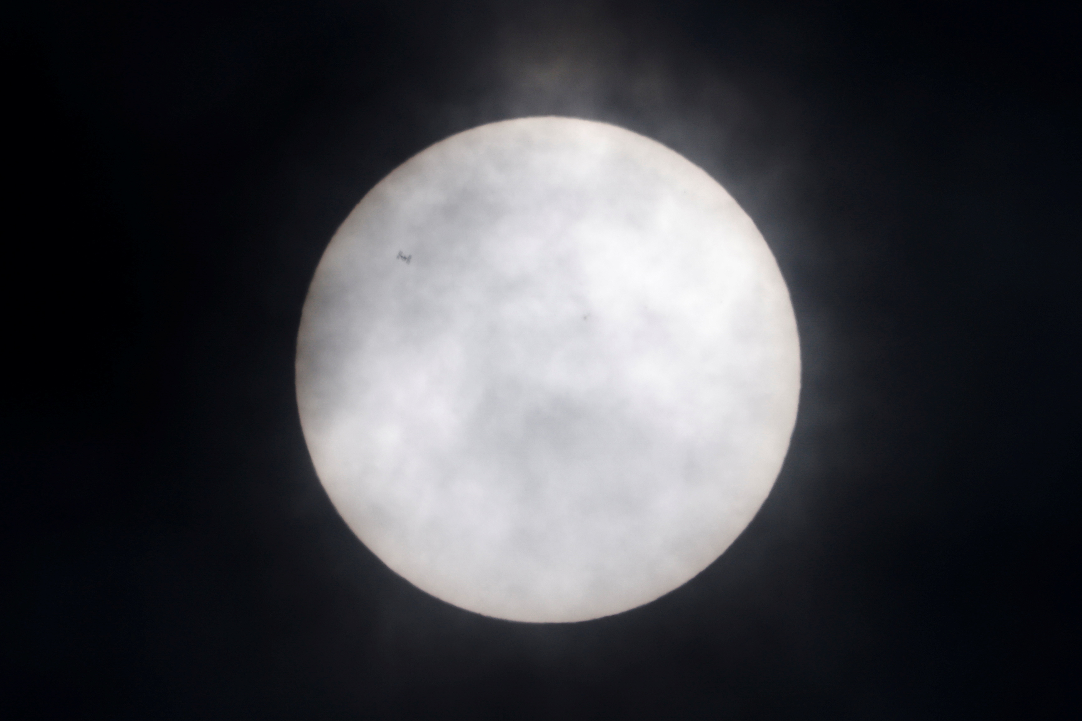 The International Space Station (ISS) is silhouetted as it transits the Sun, as seen from Shanghai, China June 1, 2021. REUTERS/Aly Song